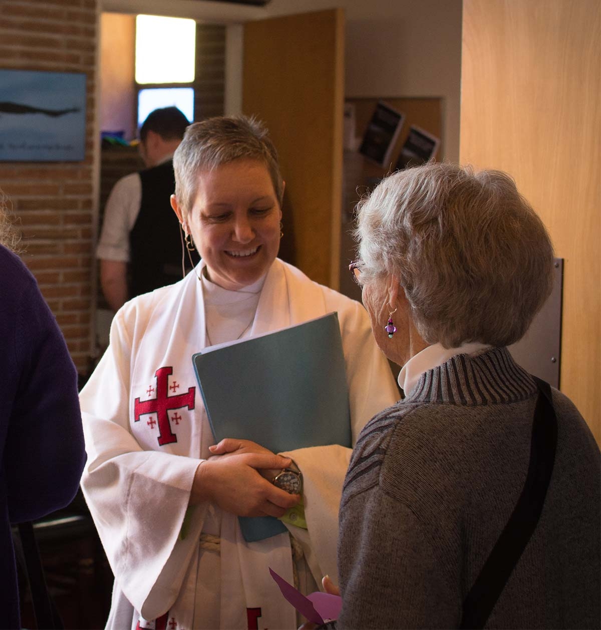 Pastor Cara Tanis welcomes guests at St. John's Lutheran Church in Bellingham, WA