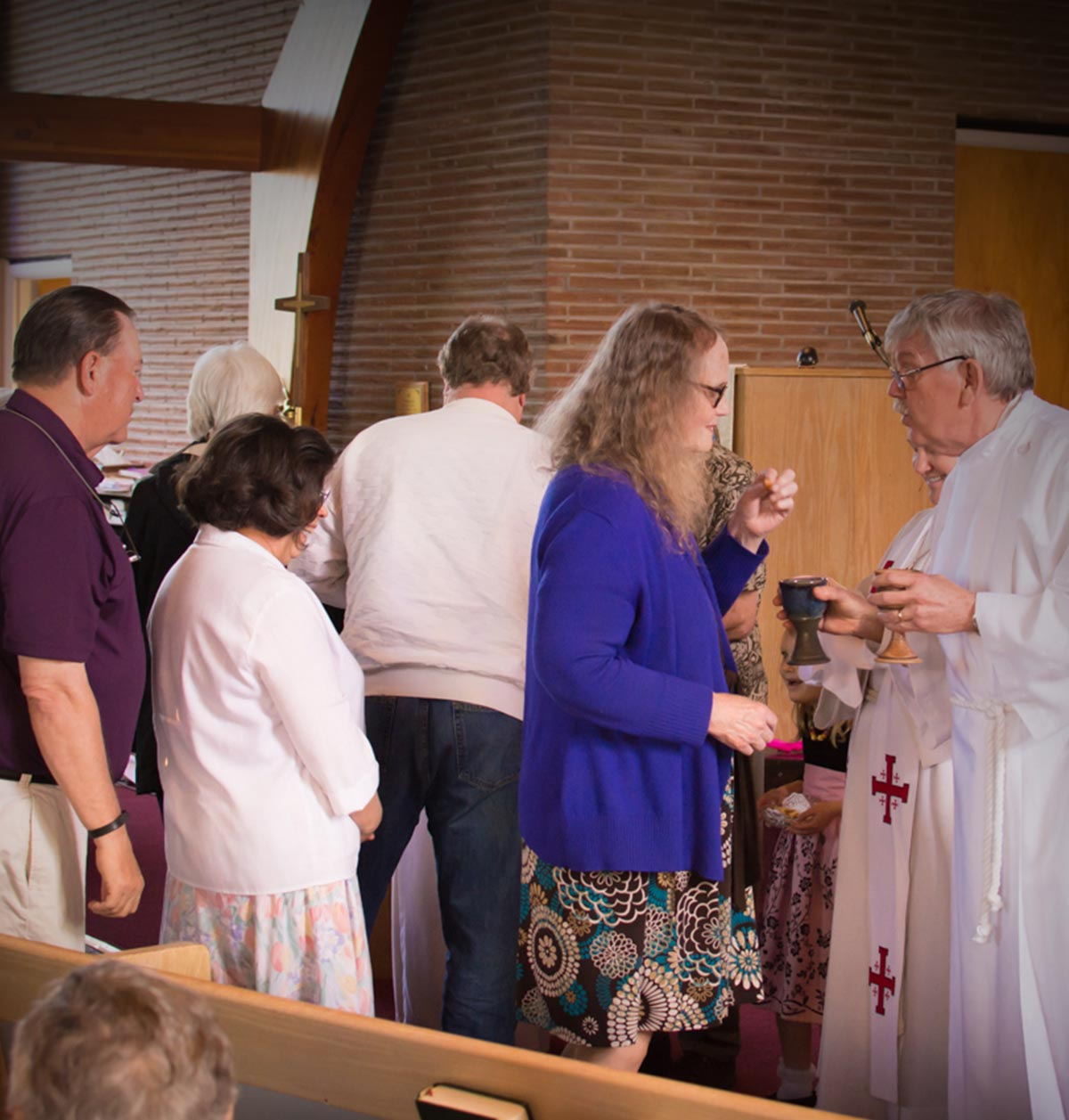 The congregation participating in communion at St. John's Lutheran Church in Bellingham, WA