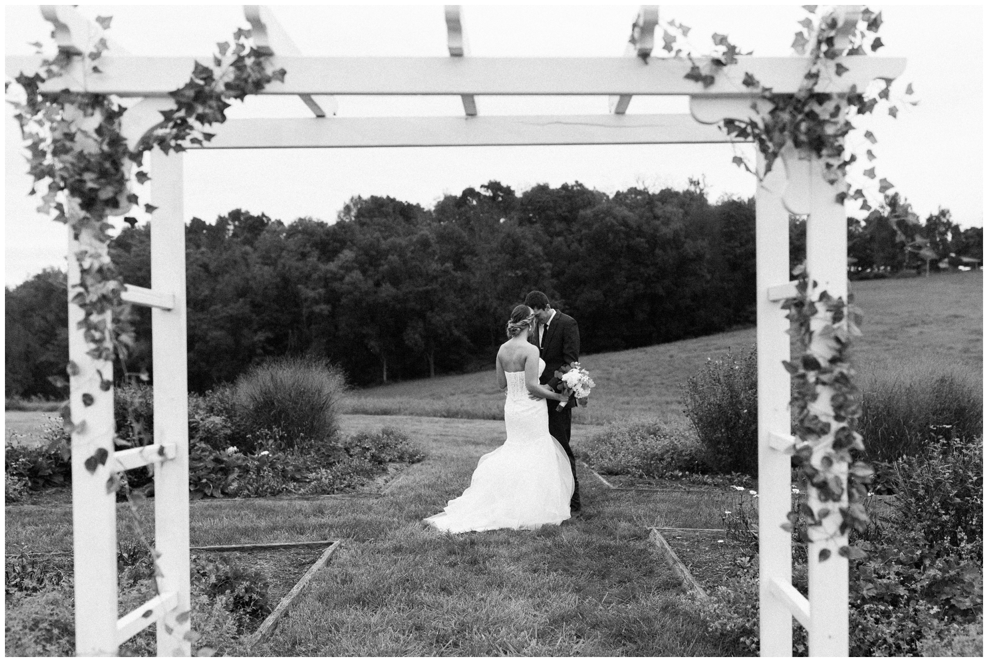 Rainy fall wedding featuring dusty blue bridesmaid dresses, bow ties and a cathedral veil at On Sunny Slope Farm in Harrisonburg, Virginia.