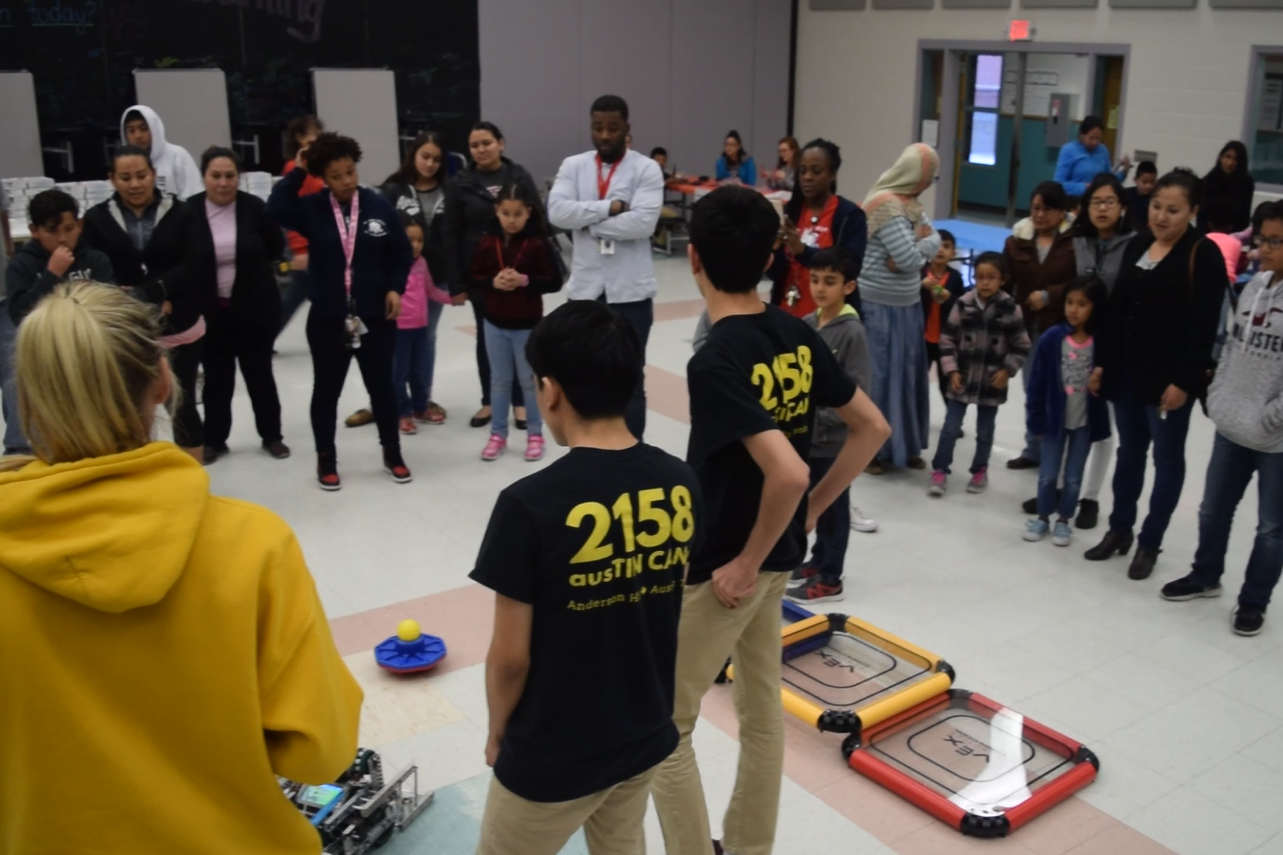 STEM at Barbara Jordan! - Some students visited Barbara Jordan Elementary on Thursday, January 31st. They attended their Science night, where different activities were put out for the students and public alike. VEX members Mauricio Hernandez and Arrash Setayesh and FRC member Leah Griffith attended to help spread STEM at the local school. Students gathered to watch the robot, hear inspirational (and punny) speeches, as well as drive one of the VEX robots!
