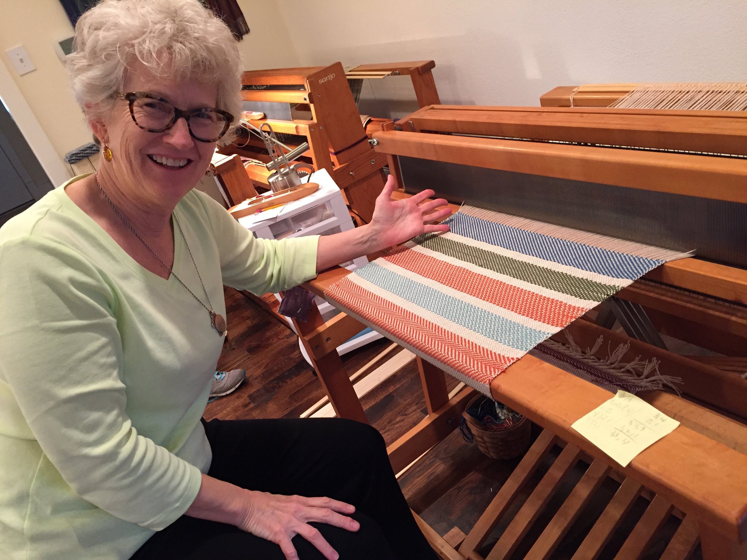 Student and her first floor loom project!