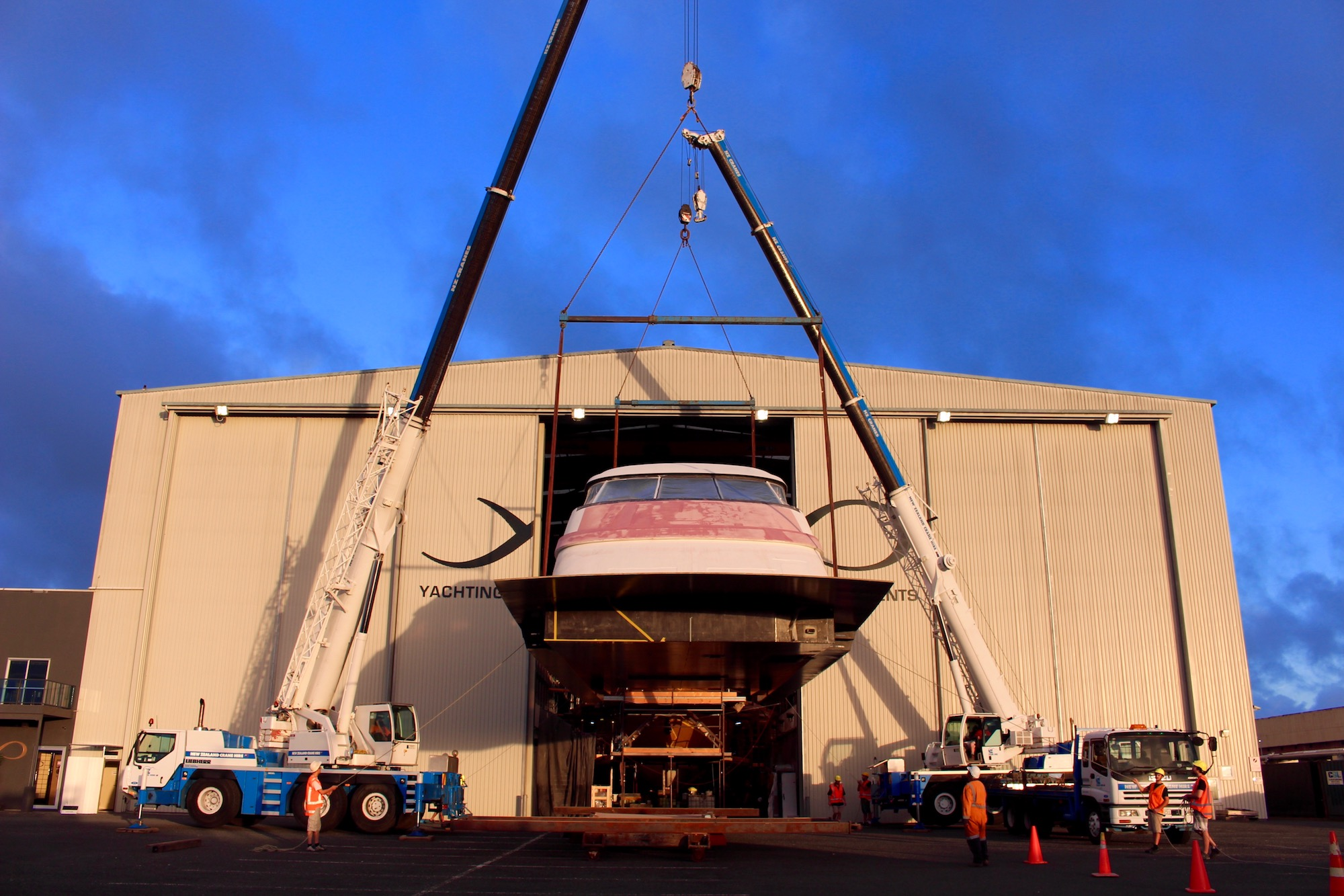 Hull 1015 superstructure is lifted on to the hull – image Paige Cook