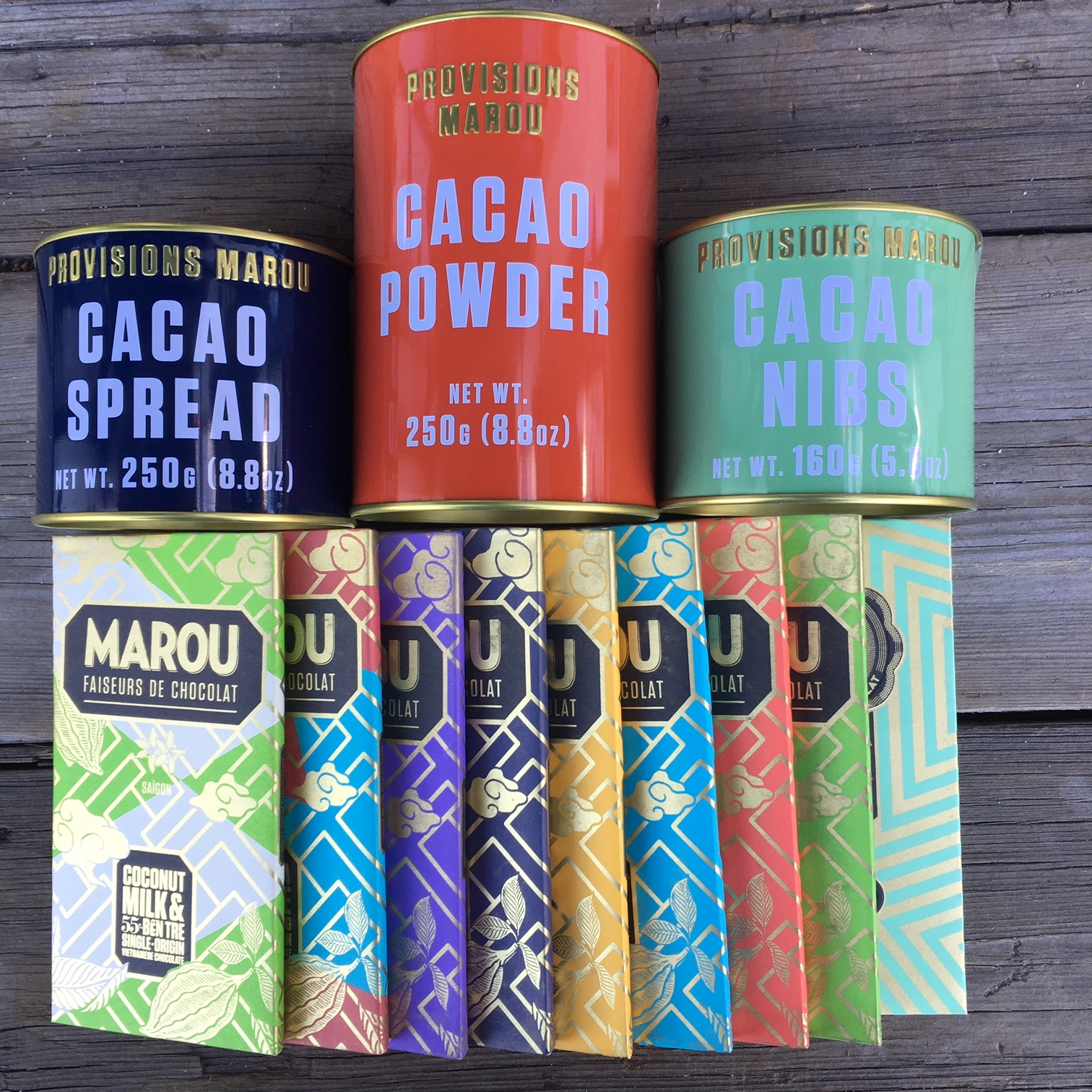 "Marou chocolate has been gracing our shelves since day one but we've just received a re-stock with some new additions to their line.  The new additions include cacao spread, cacao powder and cacao nibs, all packaged in beautiful, reusable metal tins.  Check out their bars, too.  They range from 70-76% single origin, 55% coconut milk and 64% arabica coffee and 75%-85% rare origin dark chocolate.  Here is a great article about Marou from the New York Times:    ""The world's most exquisite bars are being made in a garage in Ho Chi Minh City."""