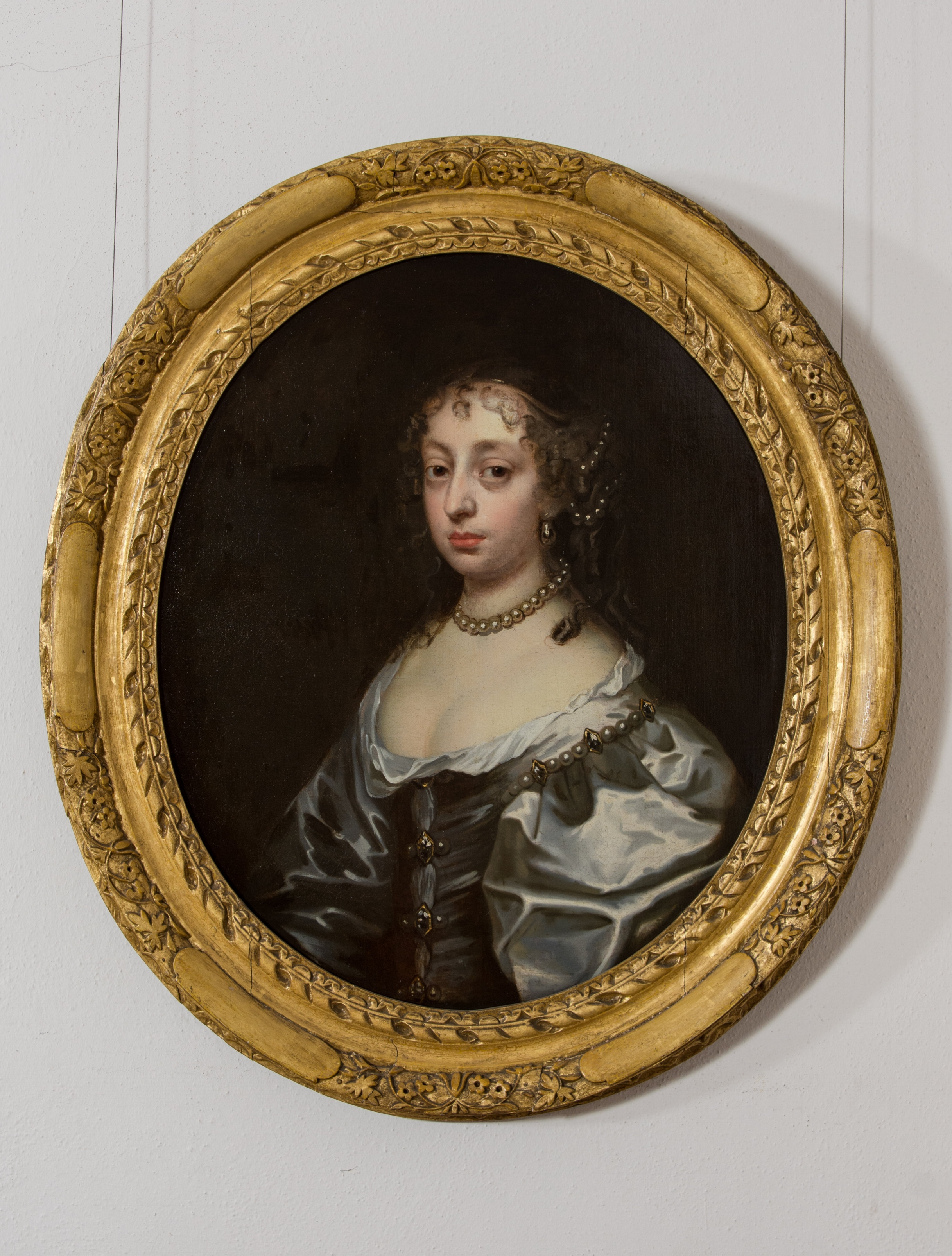 Portrait of a Noblewoman, wearing a blue dress, with pearls