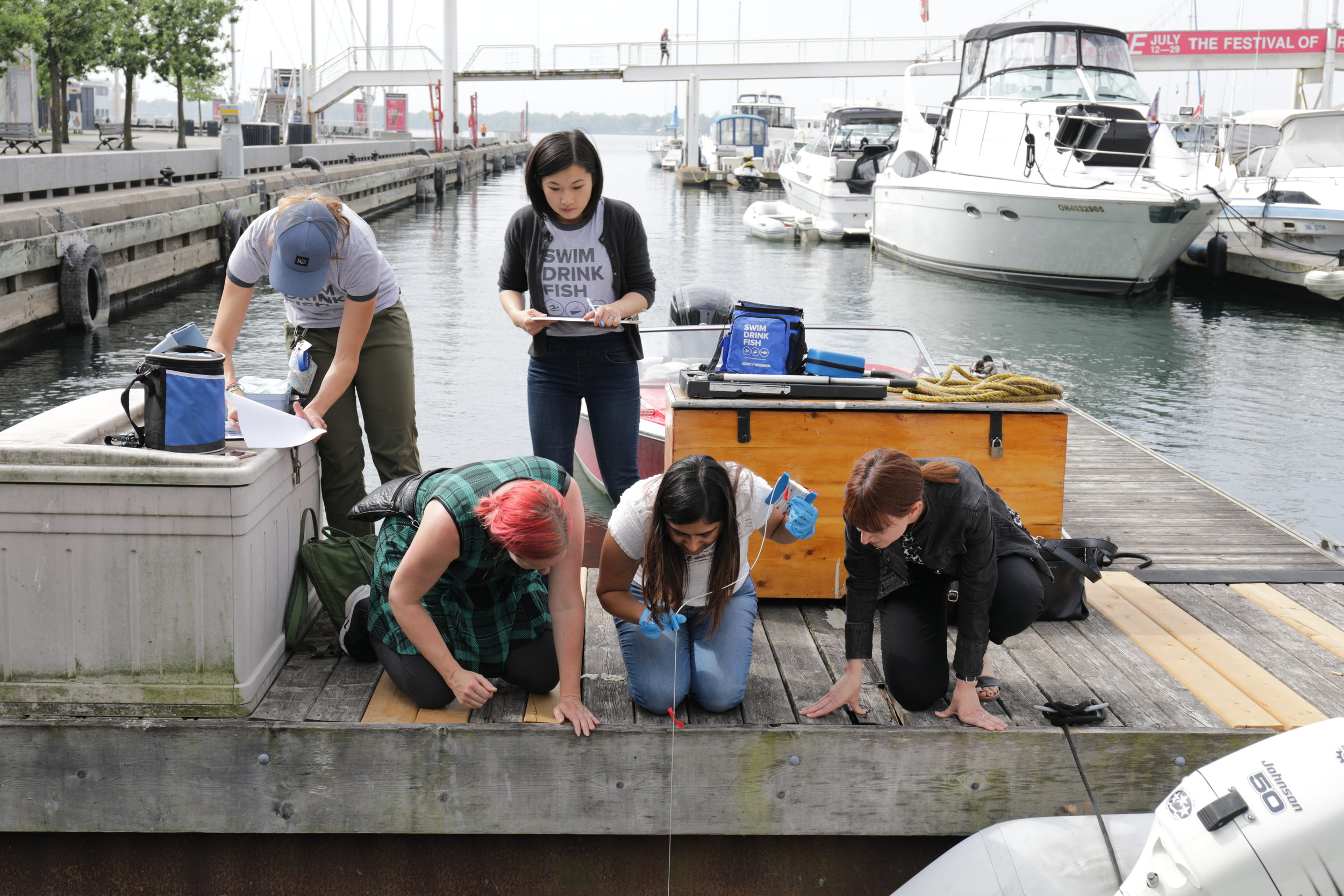 Swim Drink Fish staff and citizen scientists monitoring in the Toronto Harbour