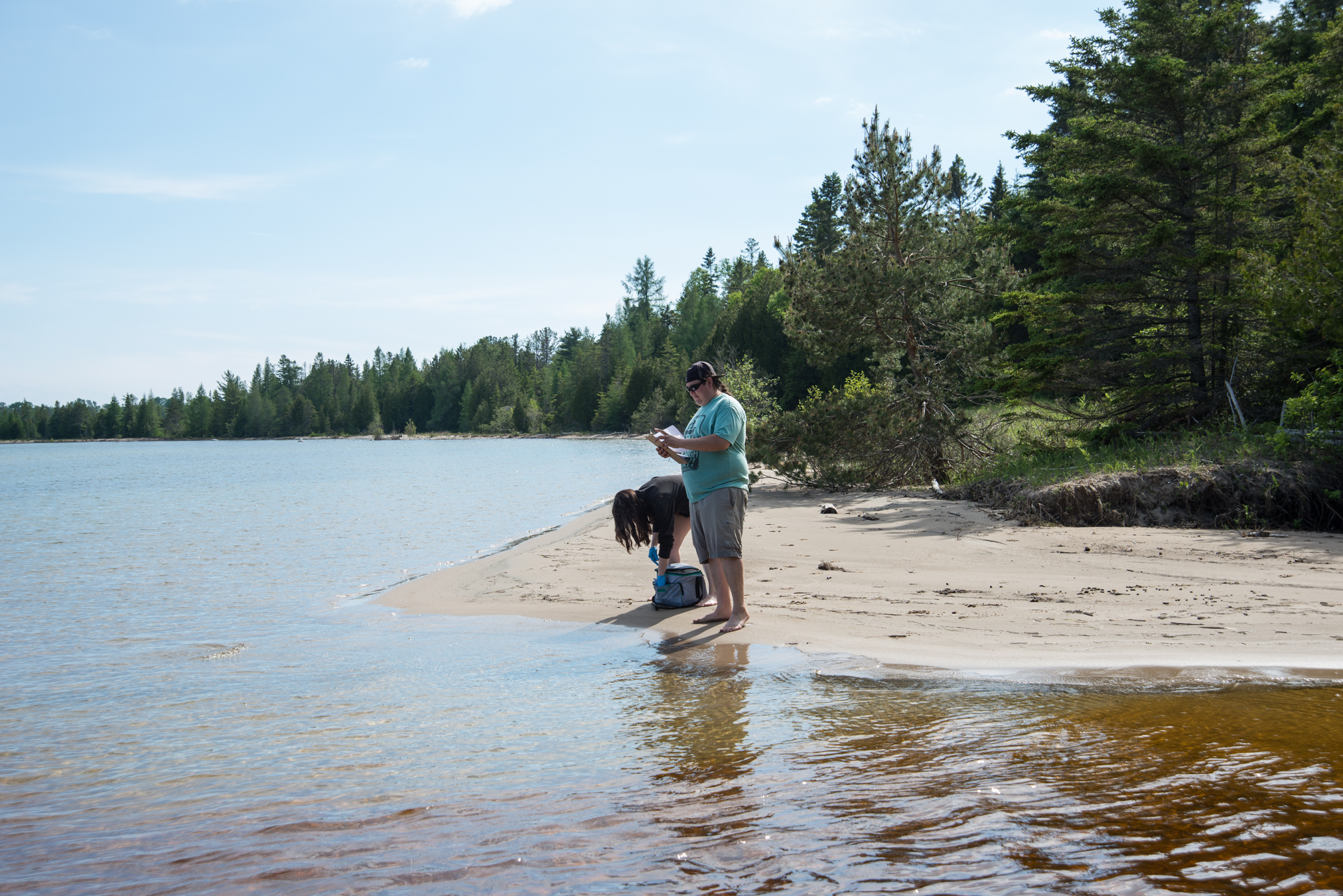 Swim Drink Fish staff monitoring in Zhiibaahaasing First Nation on Lake Huron