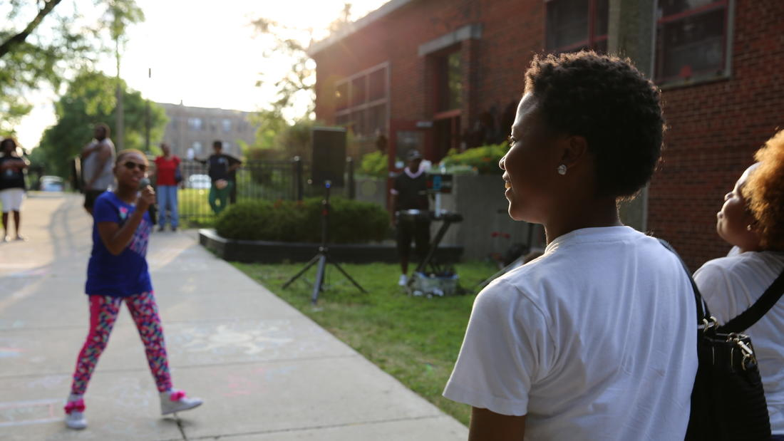 """9-year-old Chicago rapper Ms. Nina performs her song """"Lip Gloss"""" for fans at the Washington Park Field House. Ms. Nina and DJ Bsyde were featured in GLMPI'S Sankofa Nights event."""