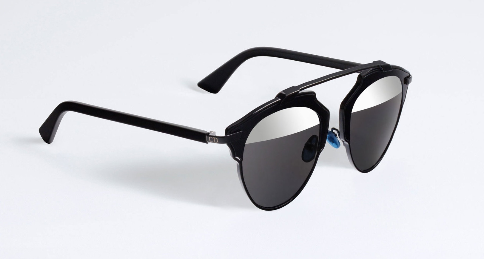 Sleek black sunnies are low-key but polished - Dior