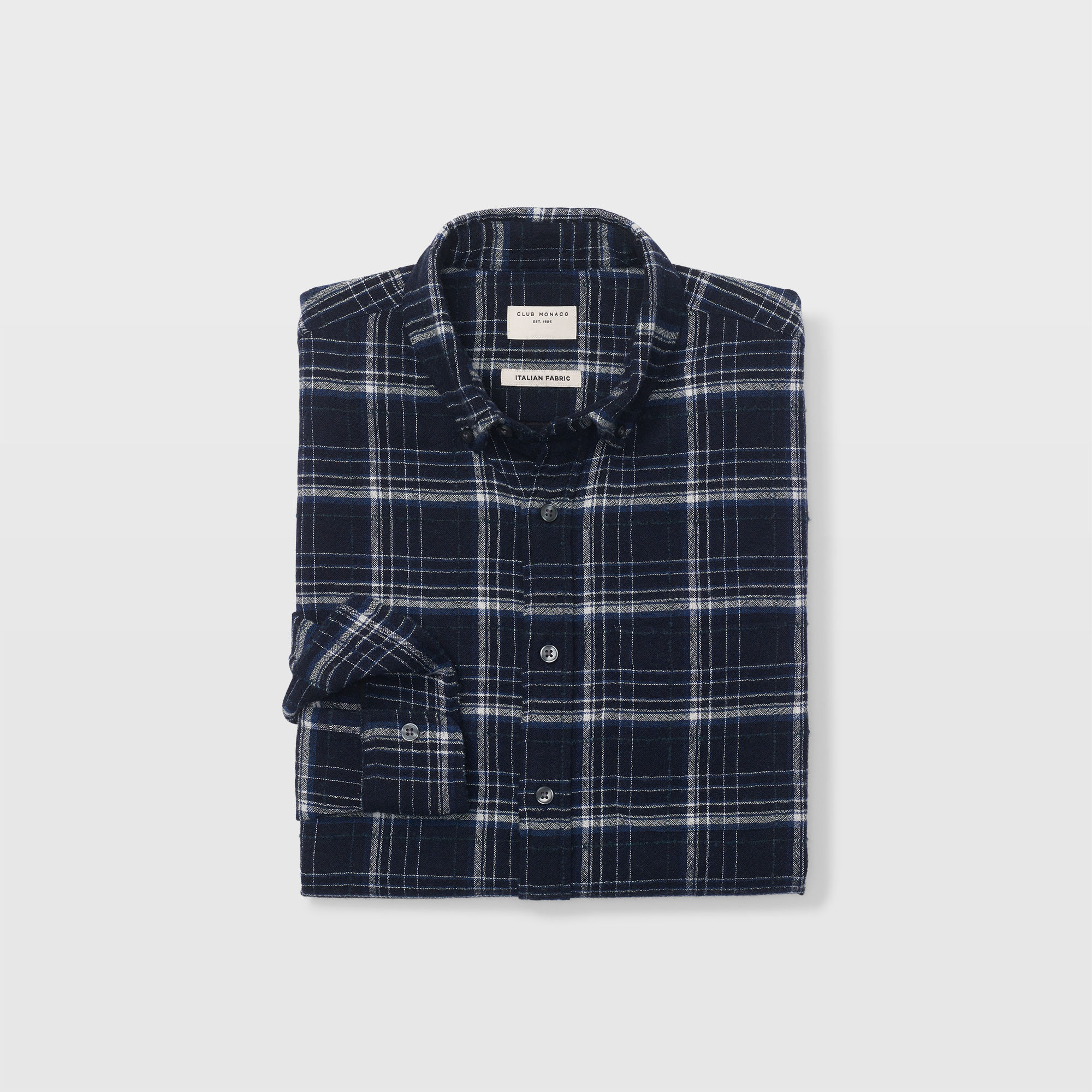 Nothing beats a flannel. A wooly texture and a menswear shape add to the appeal. - Club Monaco