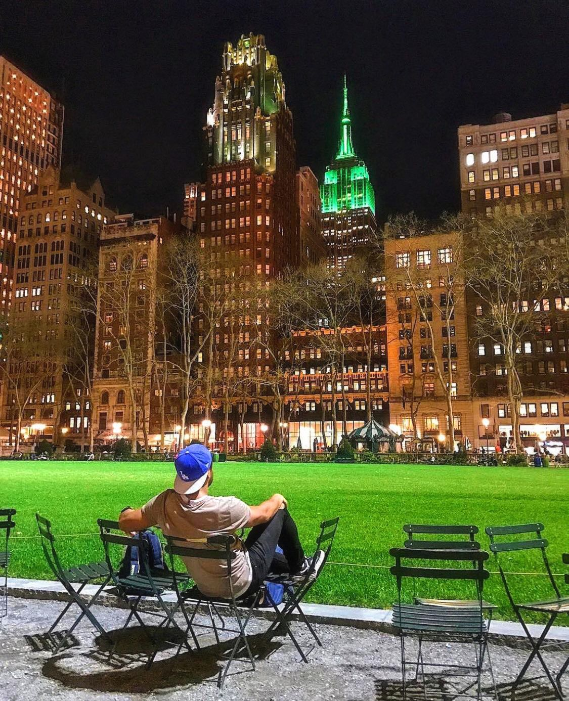chilling out in bryant park admiring an iconic landmark and the green atmosphere