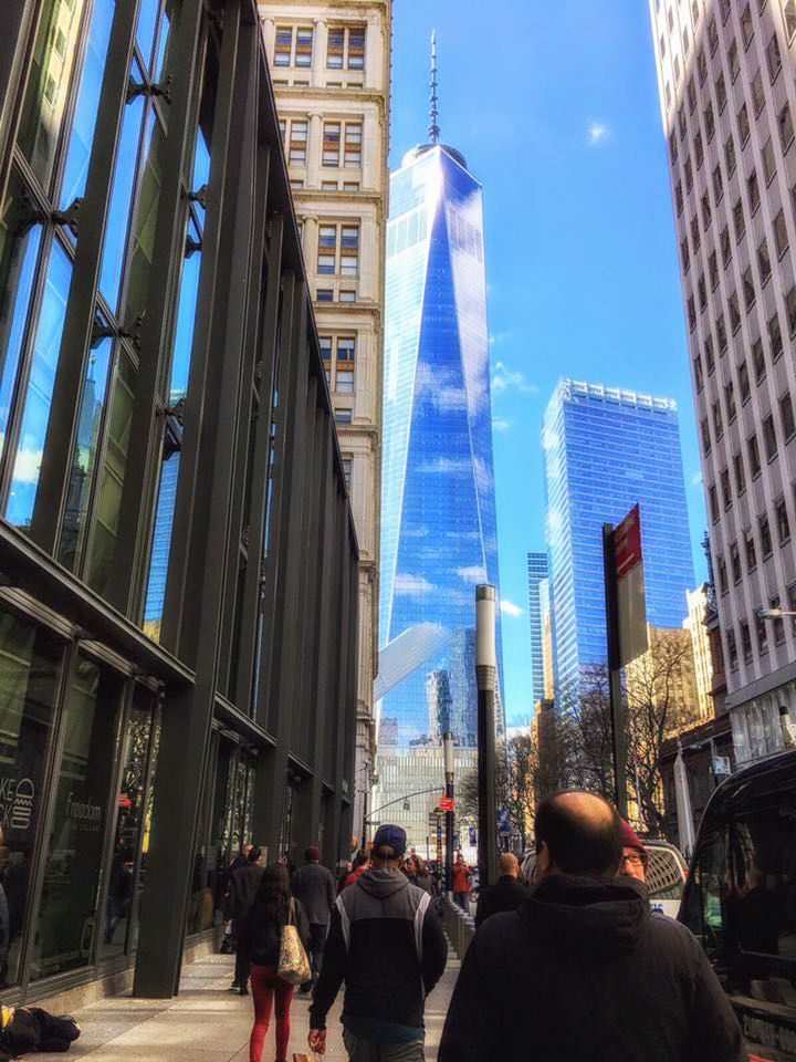 lower manhattan surrounded by blue sky : onw wtc seen from fulton street by the fulton center