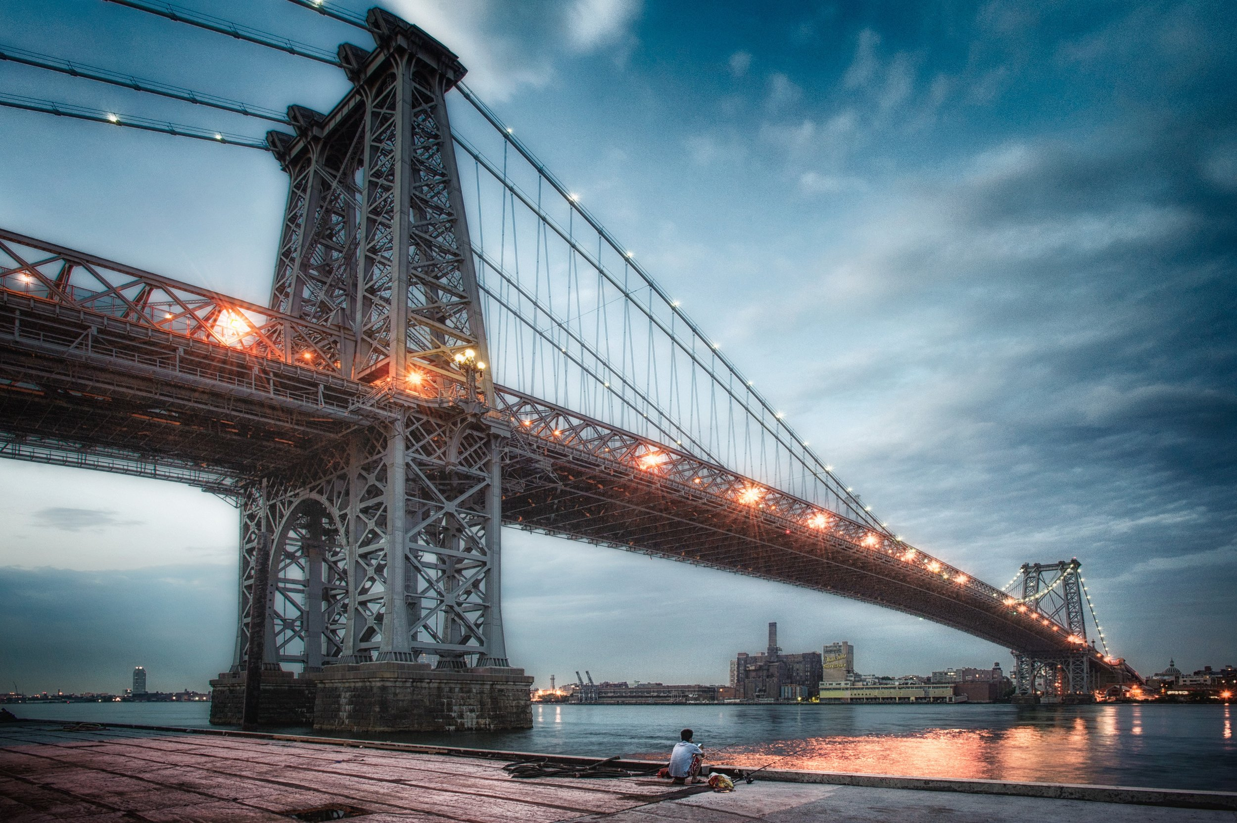 The Williamsburg Bridge stretches over the East River, connecting Lower Manhattan to Williamsburg, Brooklyn, and carries the J, M and Z subway lines, a bike path and a walkway, in addition to its eight lanes of vehicle capacity
