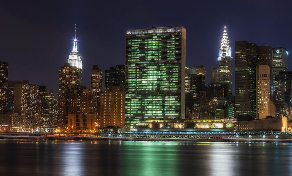 this is one of the best spots to photograph manhattan: long island city. in this photo: the empire state building (left), the united nations hq (center), and chrysler building (right).