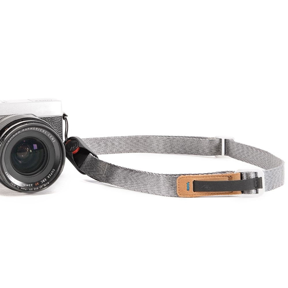 Camera strap: Some cameras will come with a strap.  Usually I toss it and replace it with a Peak Design strap . They're strong, stylish, and overall just fantastic. Don't worry, they work on digital and film cameras alike!