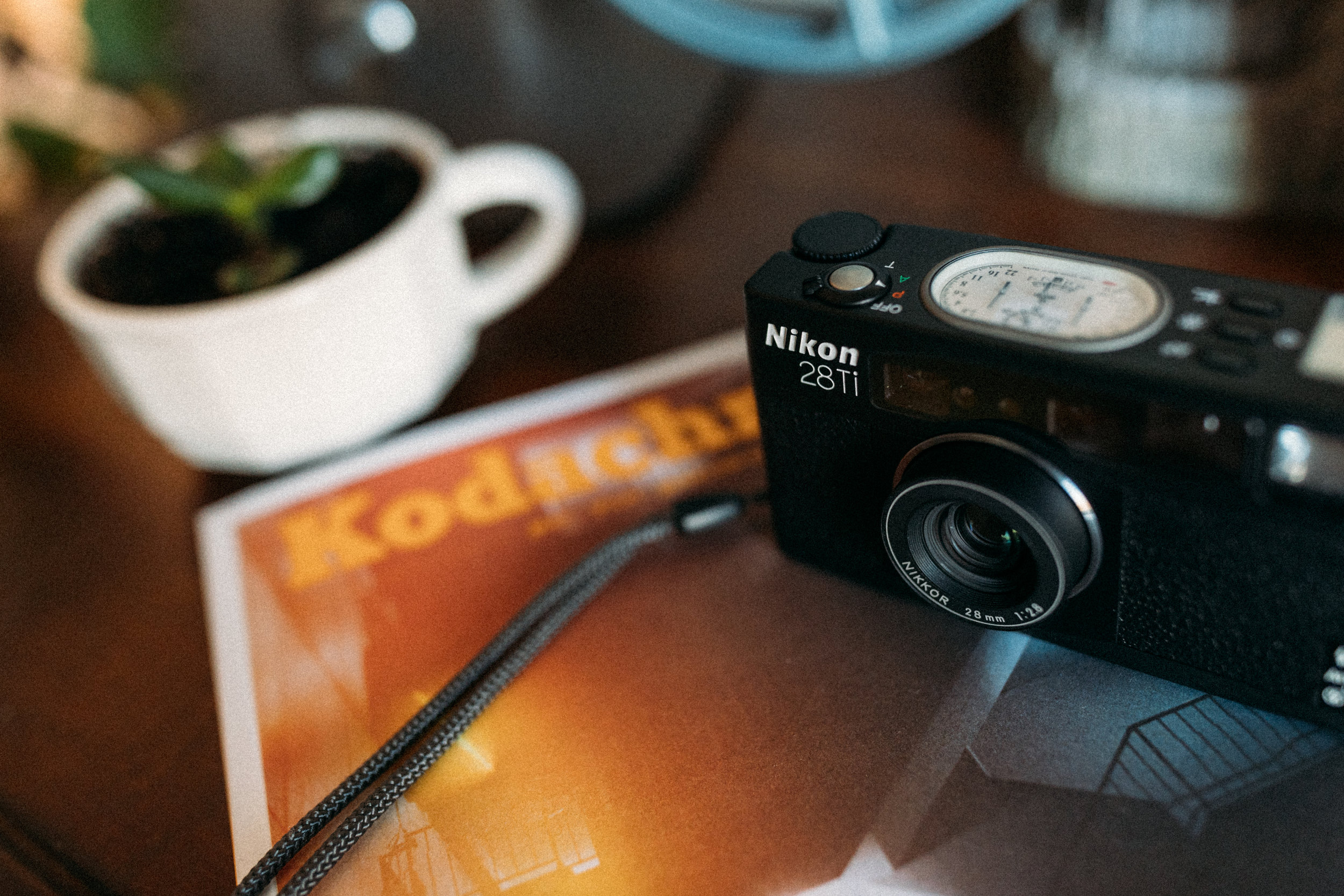 Nikon's amazing 28ti alongside Kodak's Kodachrome magazine issue two.