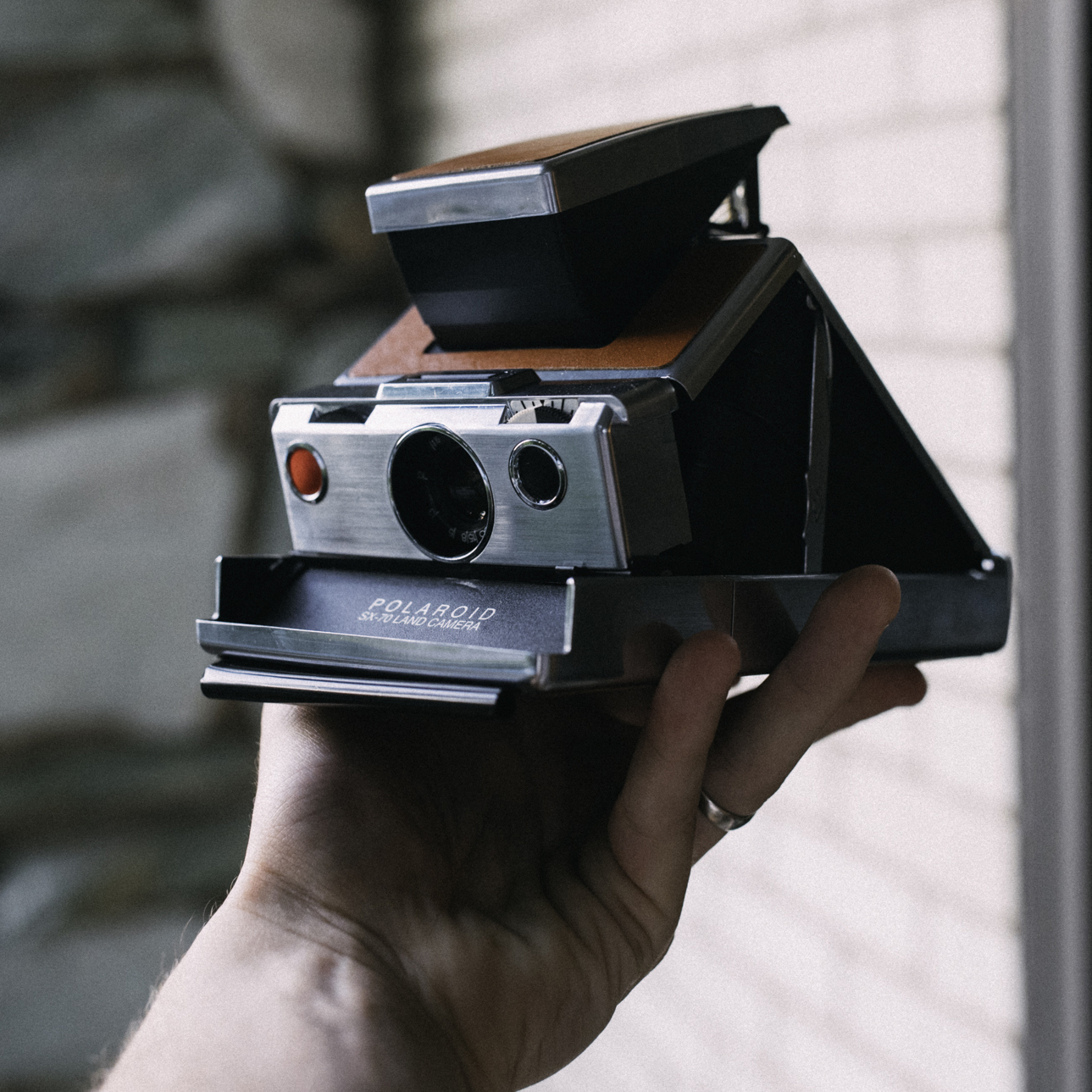 The Polaroid SX-70. Isn't she beautiful? It's amazing all of the mechanical intricacies hidden behind that leather.