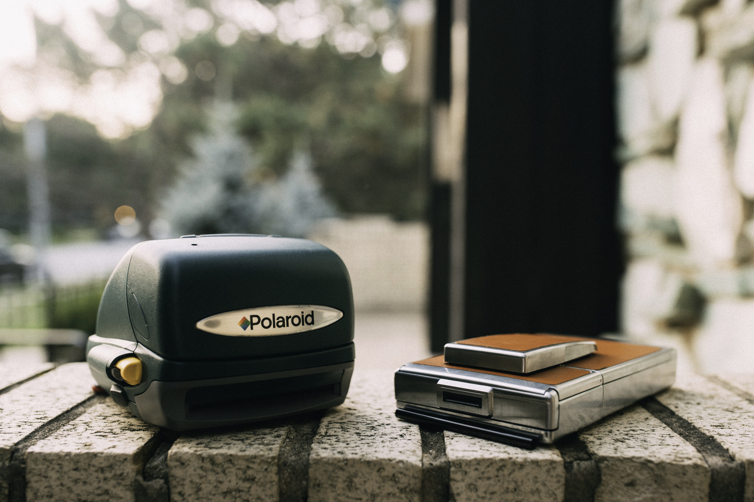 The SX-70 really is compact. Take a look next to one of the newer folding Polaroids.