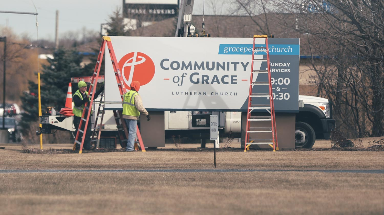 Sign installation at Community of Grace