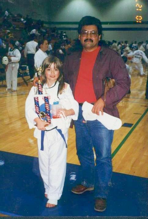 Courtney and her dad at her first Taekwondo tournament, Oct 1997
