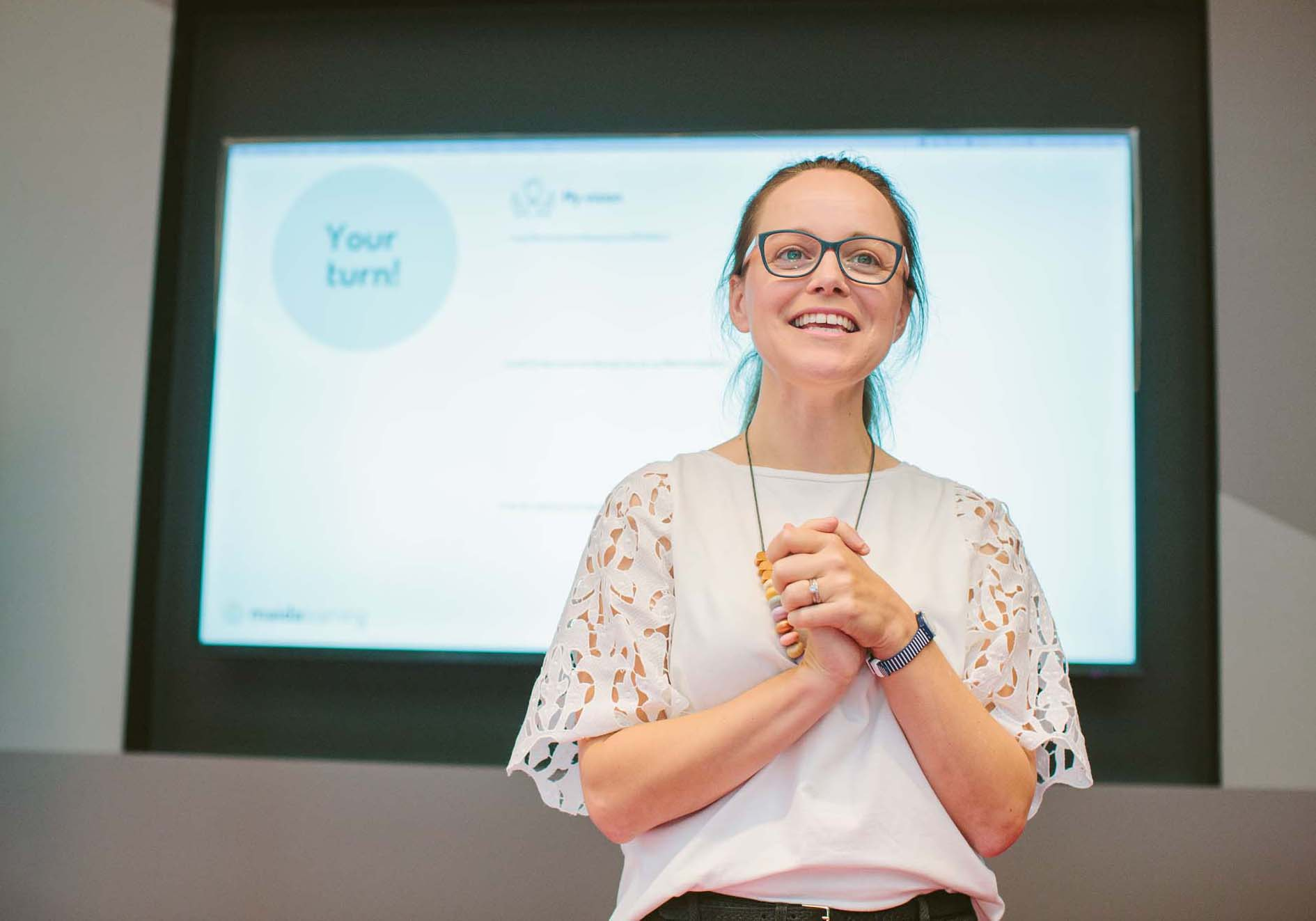 event photography woman presenting in front of slideshowS.jpg