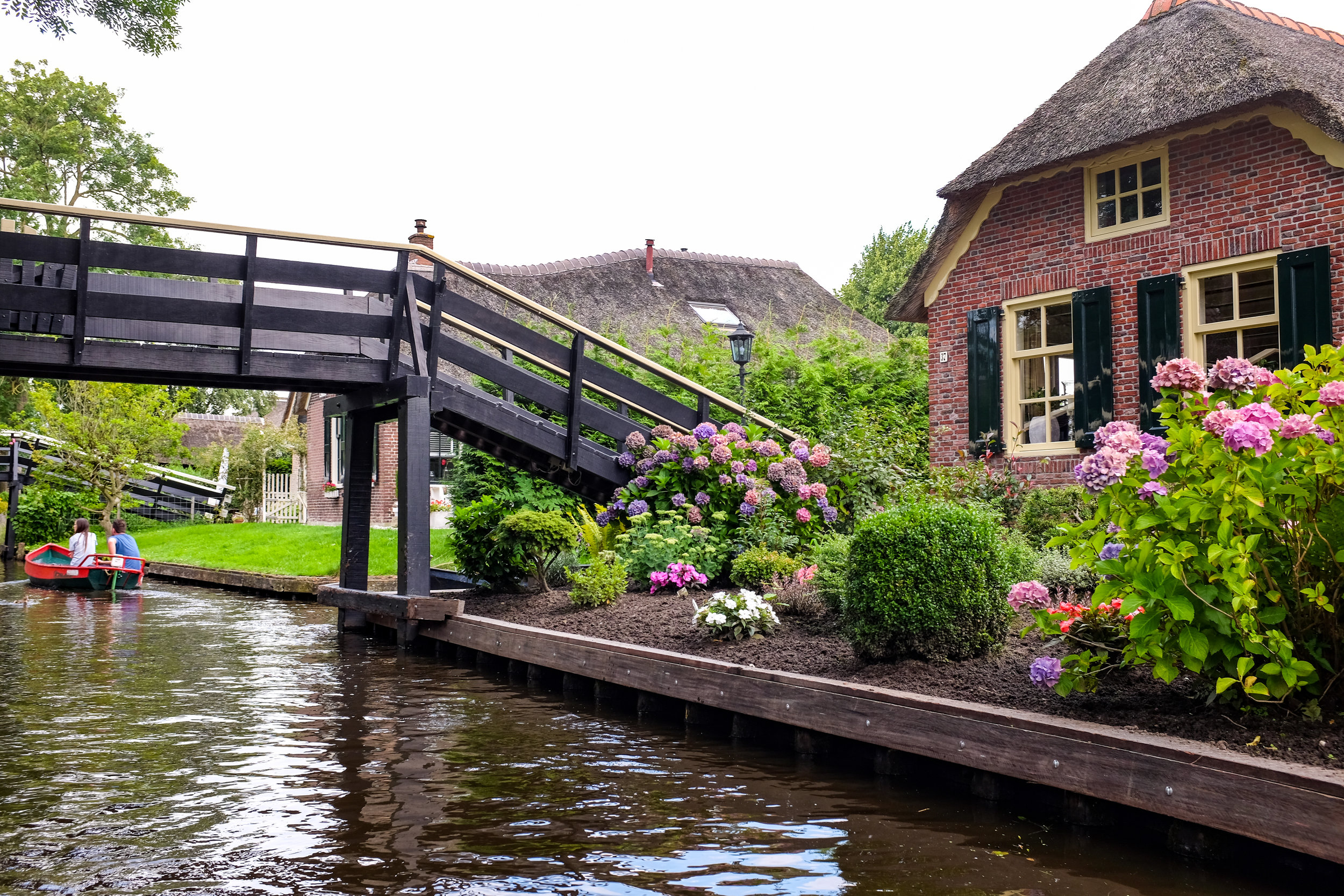 View from the boat: beautiful Dutch houses by the canal