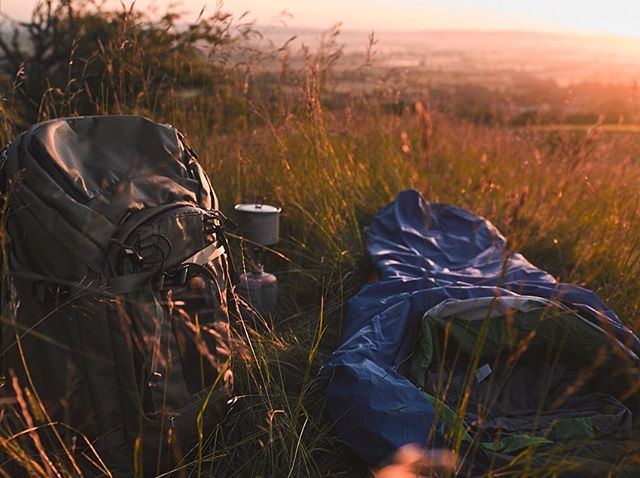 I have this little tradition. Every year for summer solstice, I take myself off somewhere new to sleep under the stars. On a hill top, on a river bank, in the dunes by the sea. To get away from the hustle and bustle of everyday life. The noise, responsibilities and 'stuff' that sounds us. Just me, a bivvy and my handy little stove. As I drove up towards the carpark, my heart sank a little as I saw and heard the noise of cars and people. It was heaving. People watching the sun going down, music pumping out of open car windows.  Of course, great that people were up there enjoying it, but... I tired up my boots, threw on my back pack and headed off in the opposite direction. Sun sets are great, but for me, it was all about where the sun would rise. I left the road, climbing over an old wooden gate, entering a field of long wild grasses silently swaying in the gentle evening breeze. Walking for a while, With the setting sun behind me, I kept climbing until I came out on to a small ridge, the land the tr North stretching out below me. The cloudless sky, which had been a bright pink, had darkened to a deep orange and red. I set up my little nest for the night, with just singing skylarks and a few sheep for company. It wasn't going to be a long sleep, but it was a very happy night, with a spectacular morning to come. . . . . . #outdoorequipment #outside #wild #intothewild #wildcamping #openair #hillside #outdoorliving #countryside #freedom #spacetobreathe #photography #photographer #lifestyle #adventure #explore #wildplaces #ourworld #exploreengland #summerdays #bivvylife #camp #getoutside #itsbetteroutside #outdoorequipment #fstopgear @fstopgear @alpkit #storytelling @hasselblad