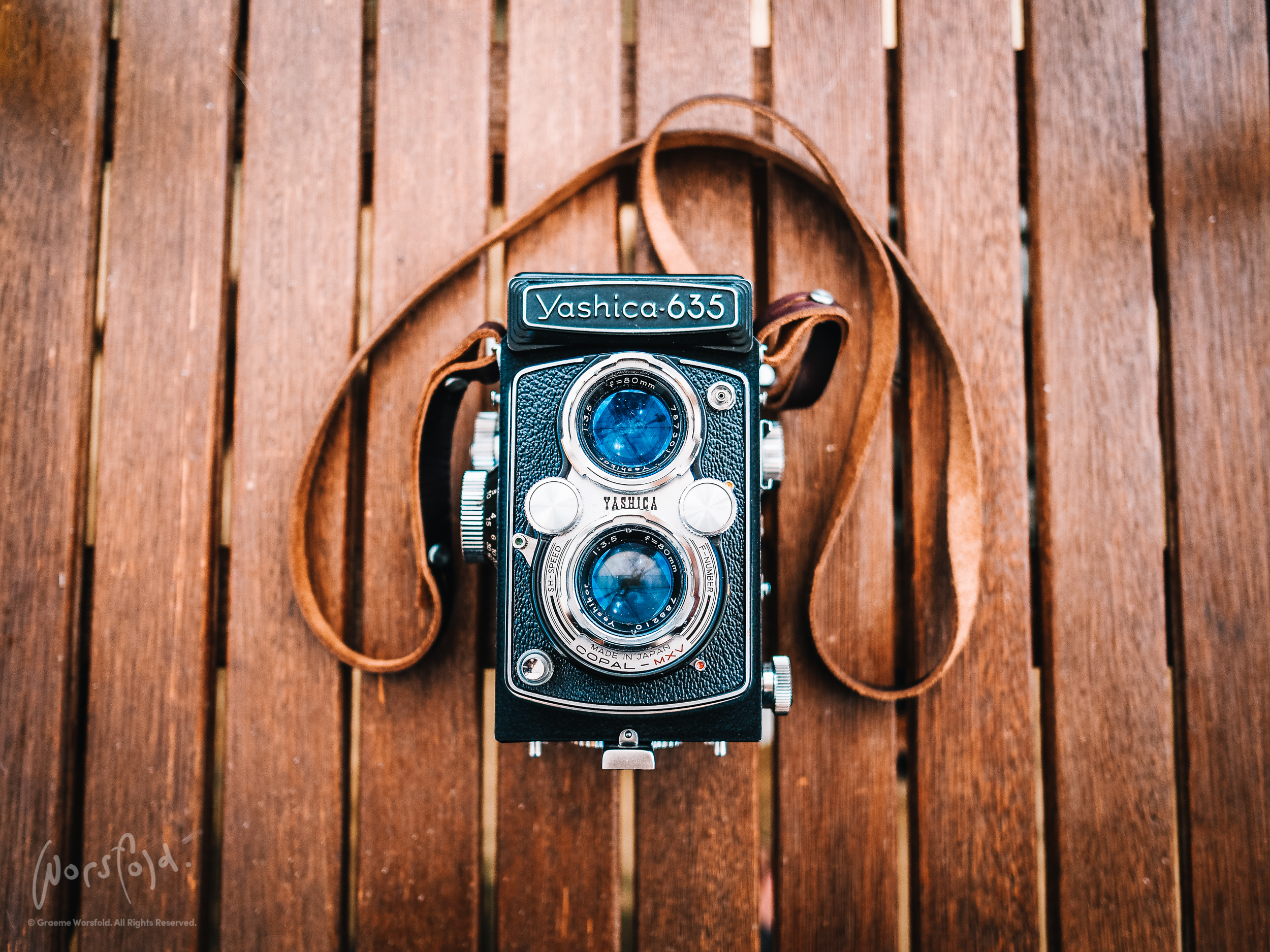Yashica 635 camera on wooden bench