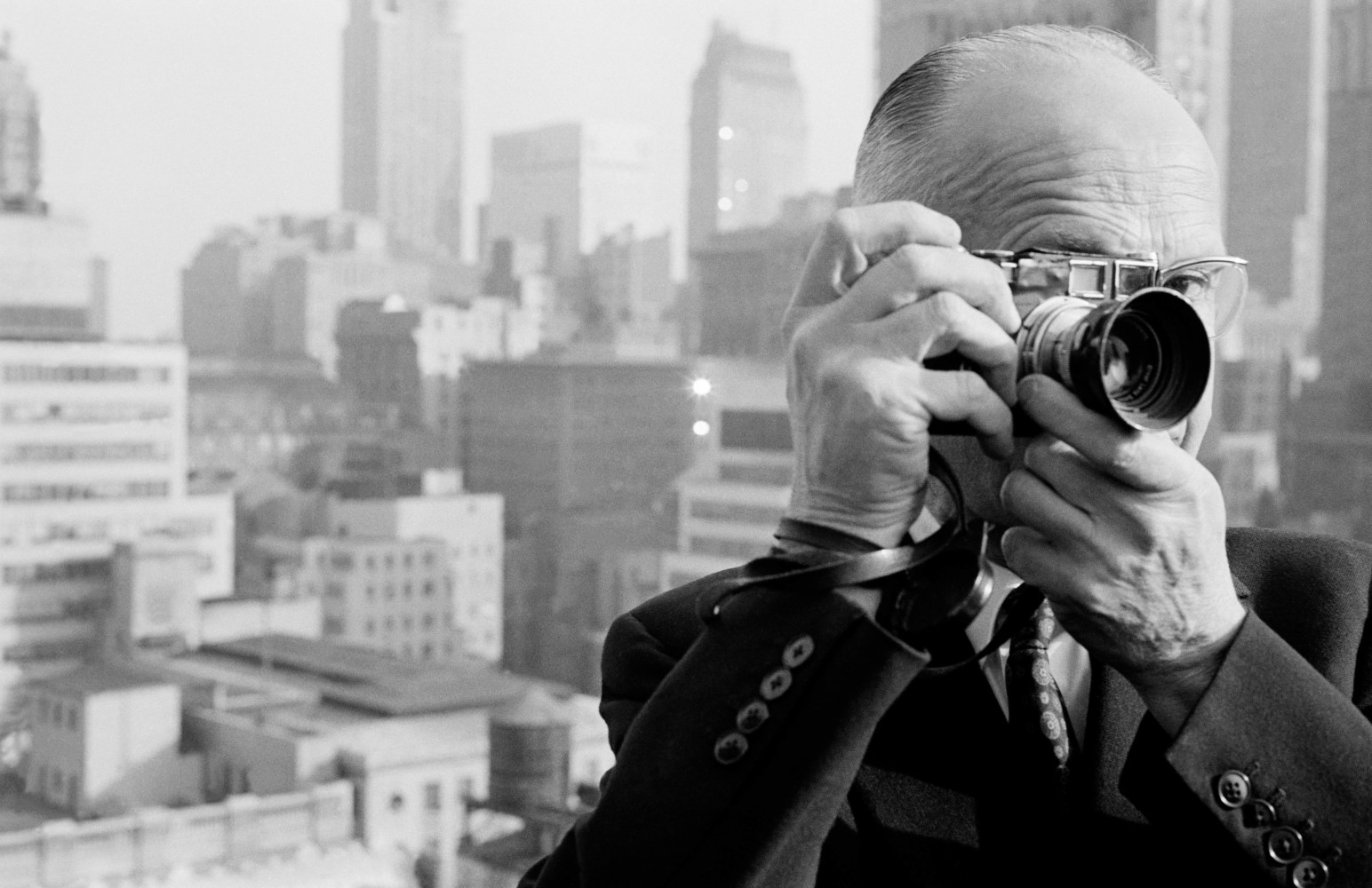Portrait of the French photographer Henri Cartier Bresson a founder member of MAGNUM Photos on the roof of the Magnum office penthouse of Magnum Photos in Manhattan on West 57th Street.1961