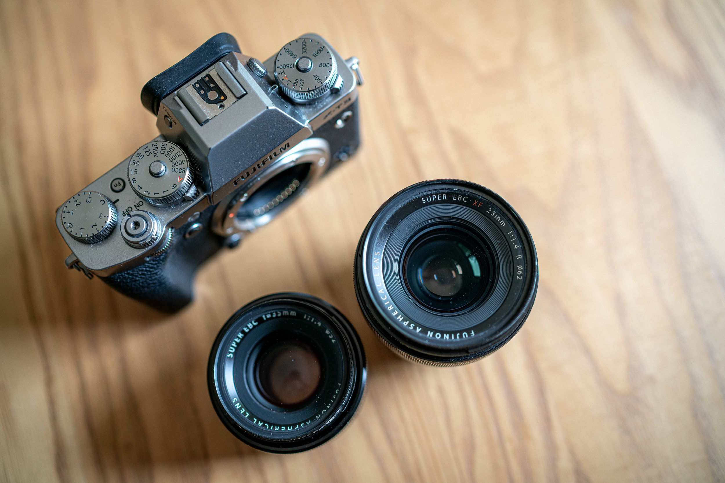 The Fujifilm XF23 and 35 F1.4. Also, note all those lovely dials on the X-T3.