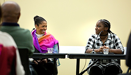 """Retired U.S. Army Major General Marcia Anderson (left) and Army reservist and College of DuPage student Tanika Moore share a story during this week's """"African-Americans in Times of War"""" panel discussion.(Press Photography Network/Special to College of DuPage)"""