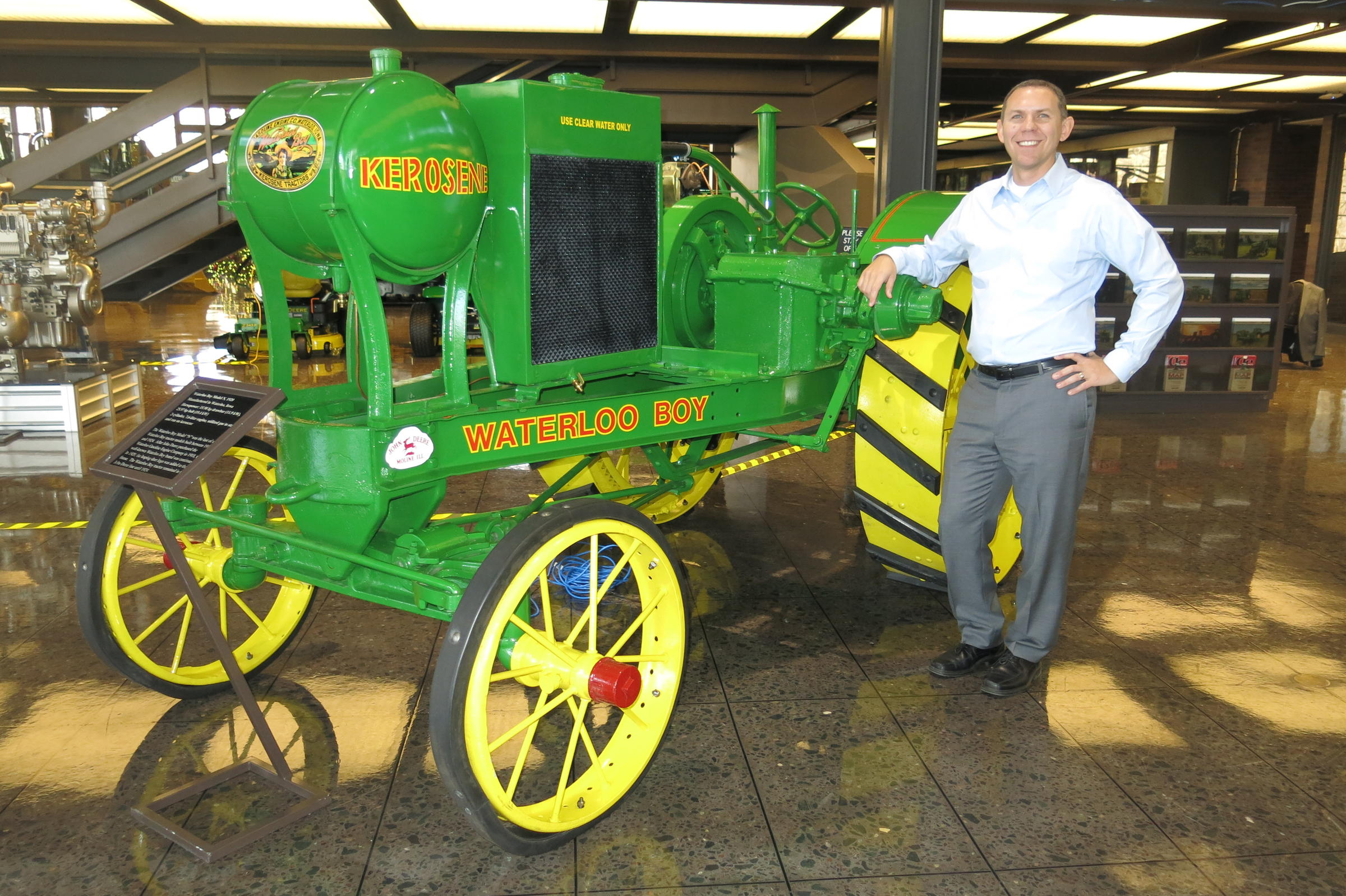 Neil Dahlstrom with a restored Waterloo Boy tractor at John Deere World Headquarters. MICHELLE O'NEILL / WVIK NEWS