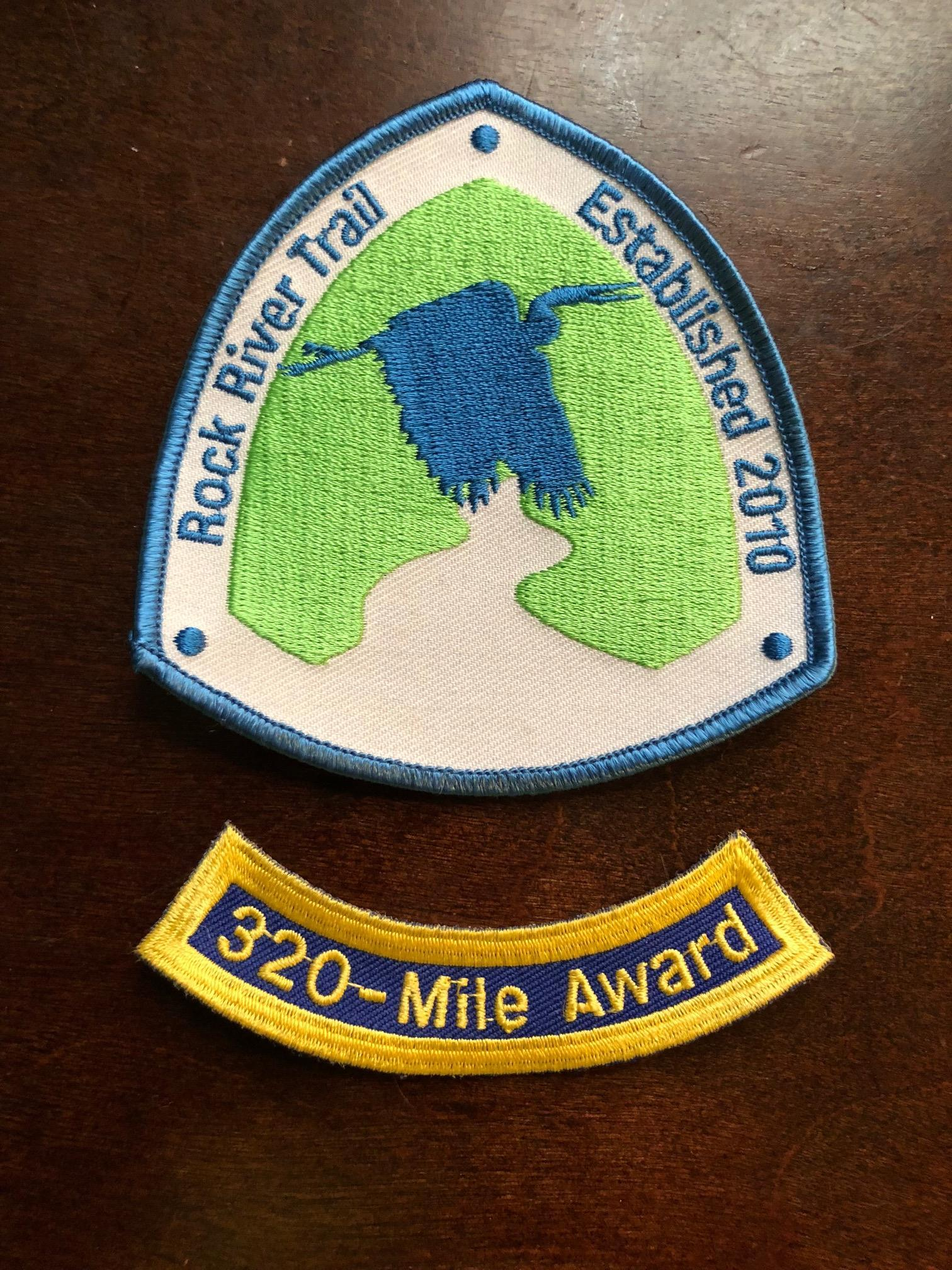 The official Rock River Trail patch with 320-mile rocker (photo courtesy of WNIJ)