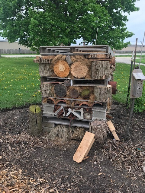 An unusual bee habitat built from discarded and broken building materials, pallets, and logs is part of the display at the Extension's Idea Garden