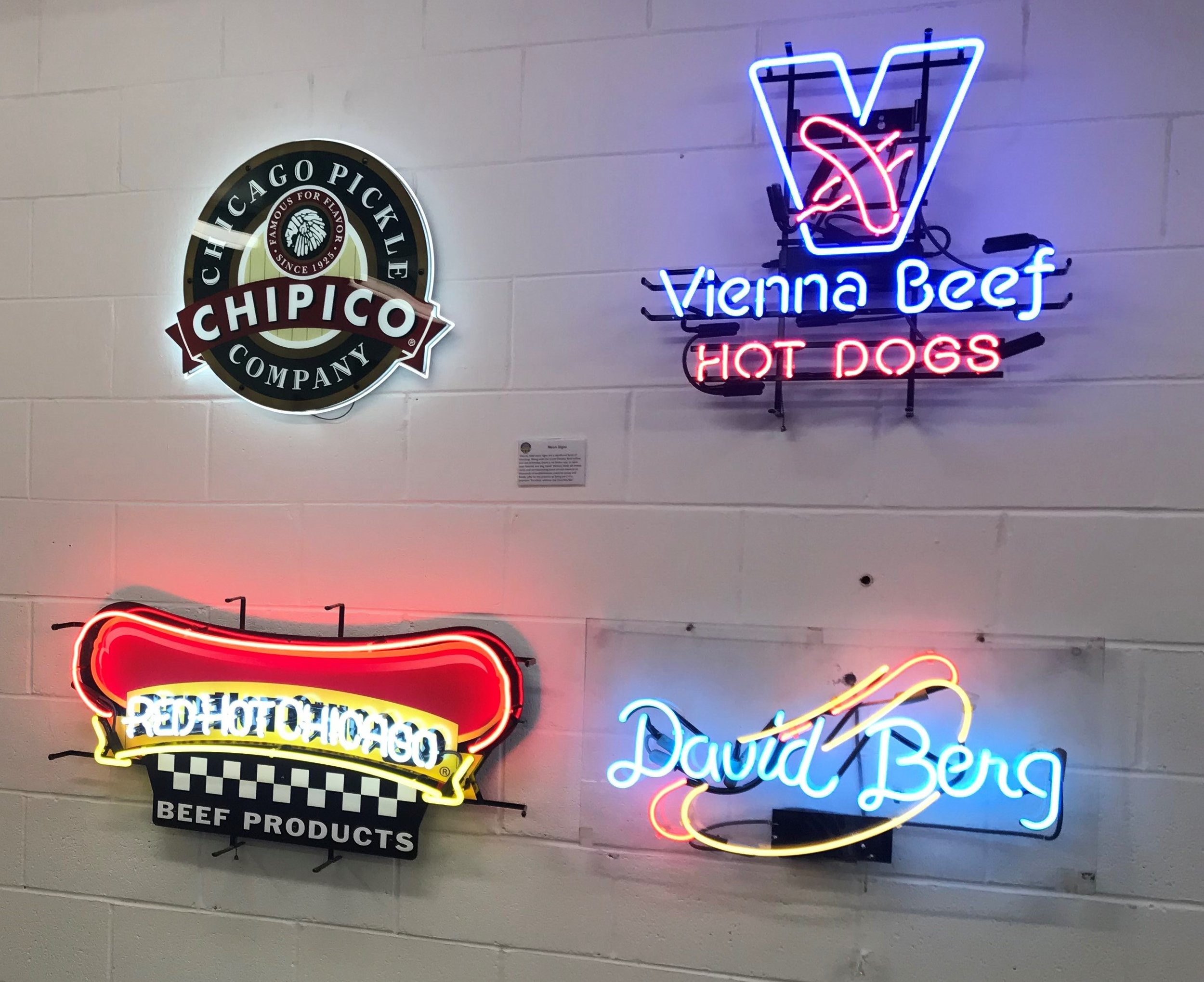 A collection of neon logos that are part of the Vienna Beef aniversary exhibit
