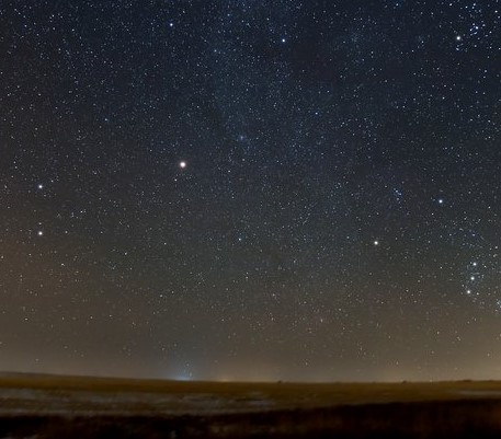 Mars (center-left) will continue to be prominent in the night sky through August (photo courtesy of NASA)