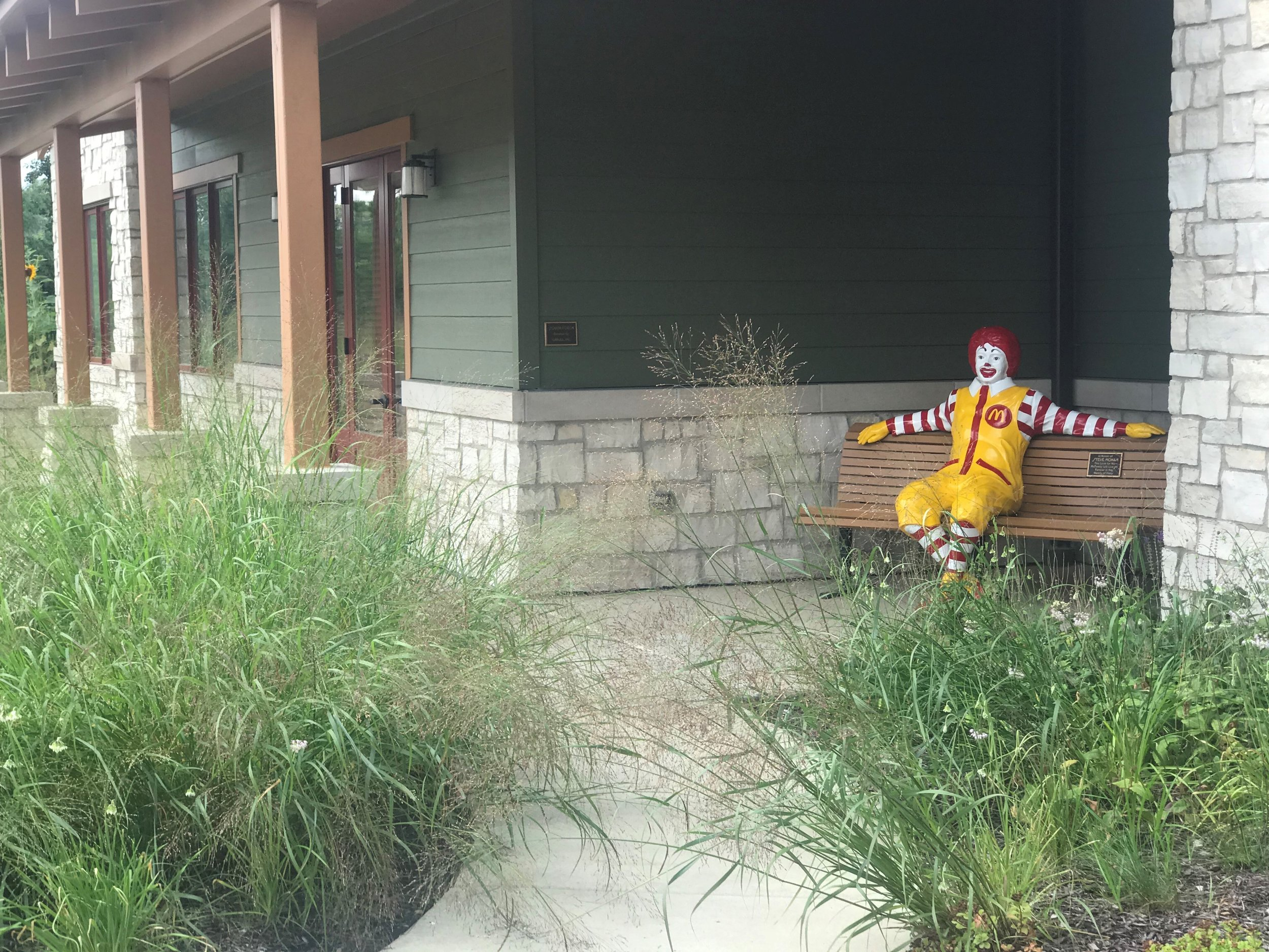 Ronald McDonald greets families from the front porch of the house in Winfield