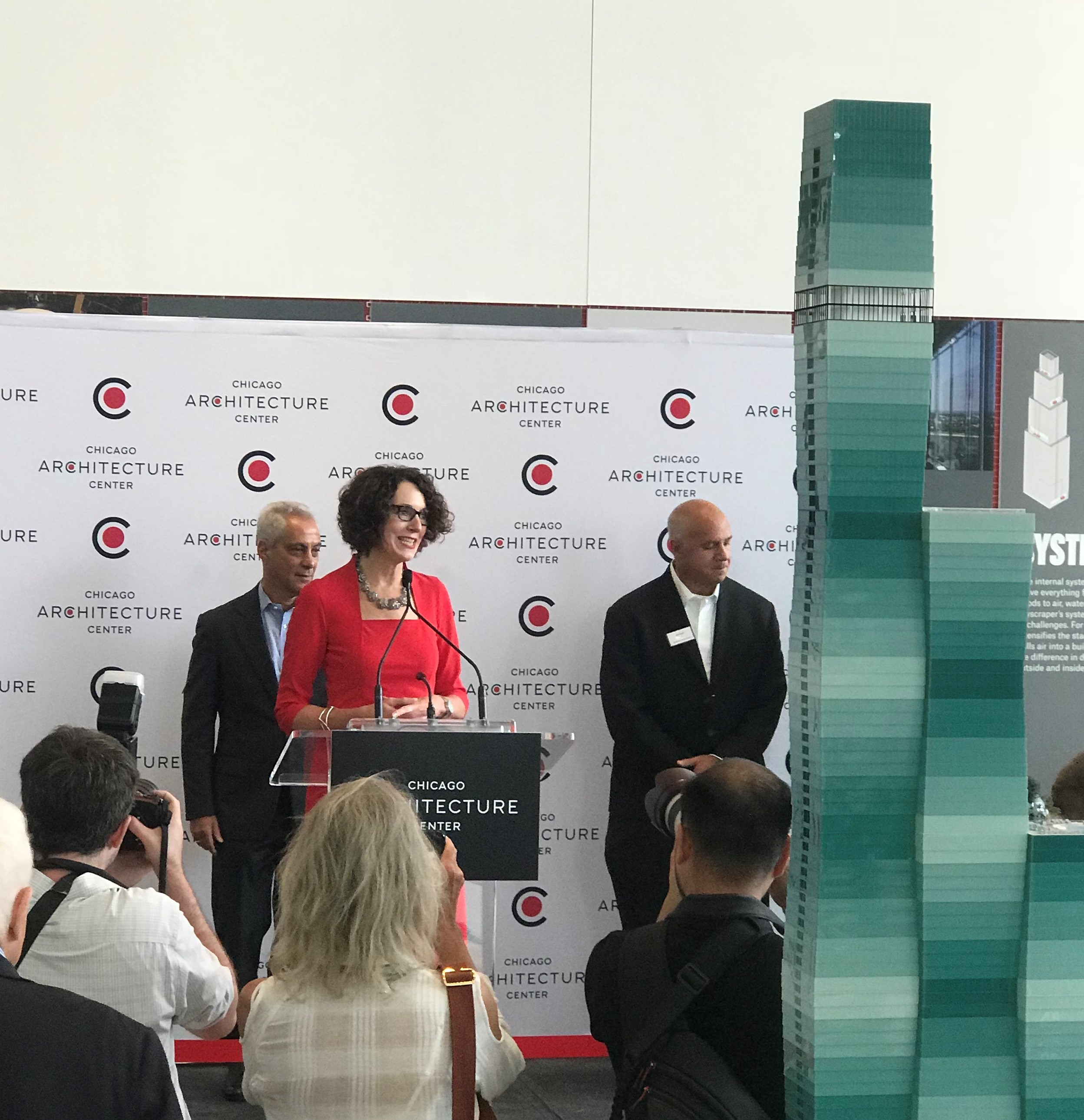 Chicago Architecture Center President and CEO Lynn Osmond tells supporters opening the new facility is a dream come true. Chicago Mayor Rahm Emanuel (left) and Architect Gordon Gill (right) joined Osmond for this week's ribbon cutting ceremony.