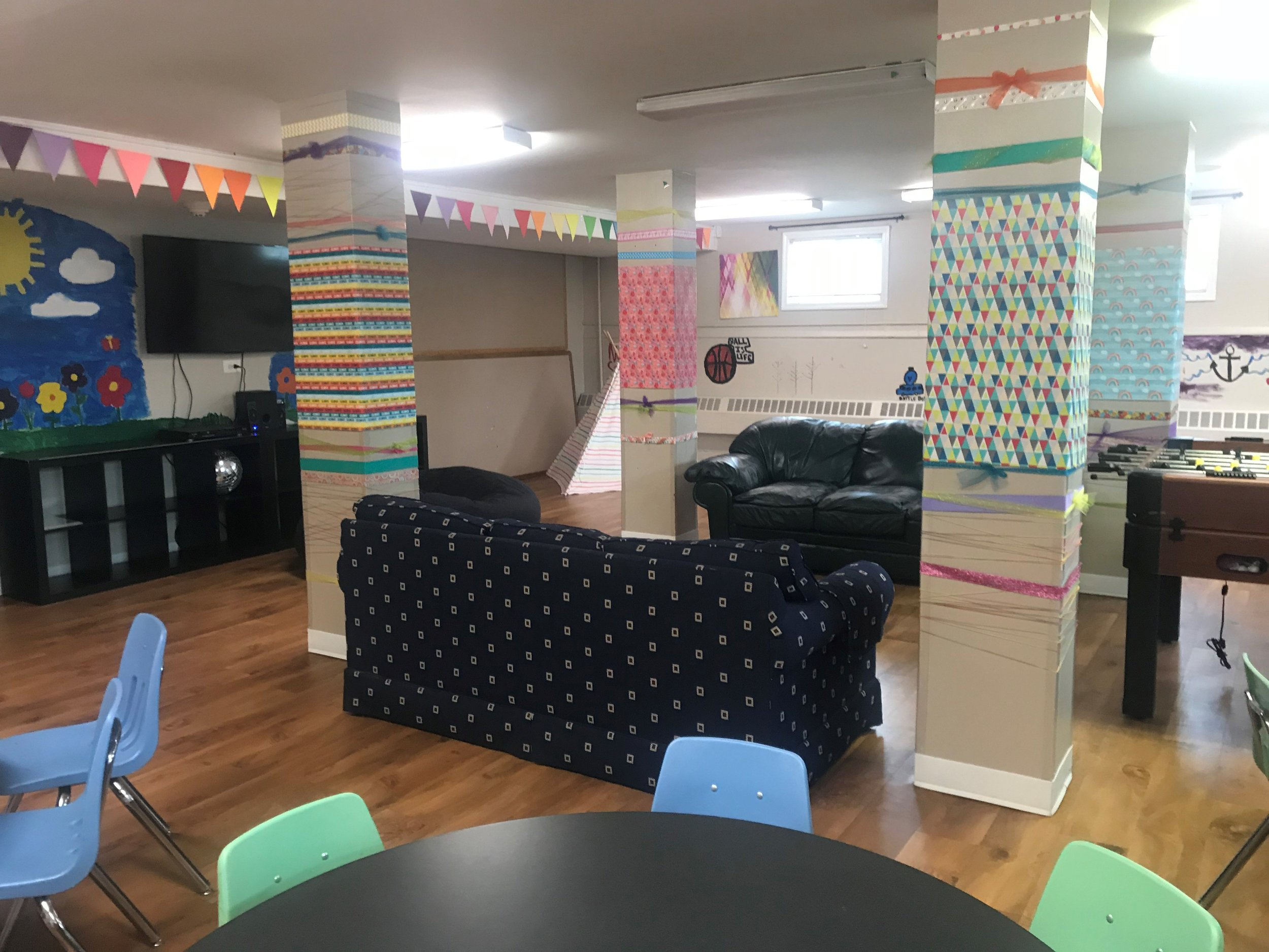 Marian Park Resident Service Coordinator Donna Iwicki worked to create an inviting space for her planned after school program for the apartment complex's youngest residents