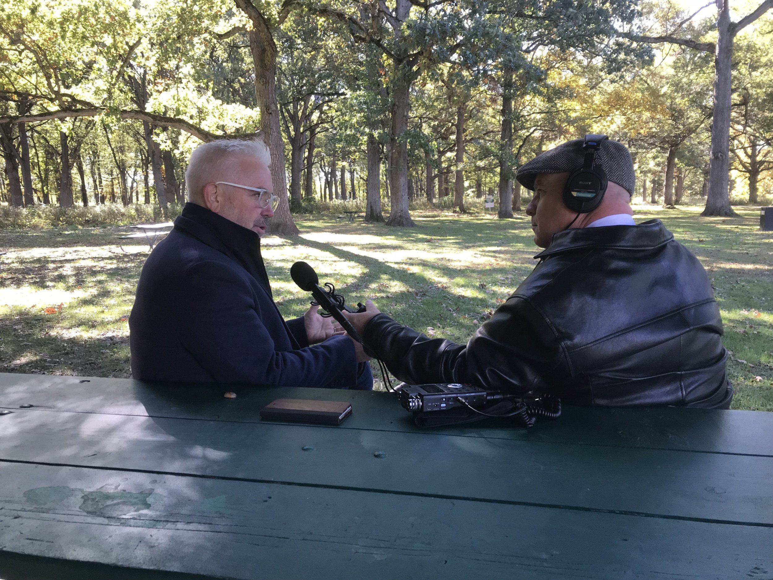 Tree-Hab creator John Gathright (left) and First Light host Brian O'Keefe talked in the shade of an oak forest at Fabyan Woods Forest Preserve