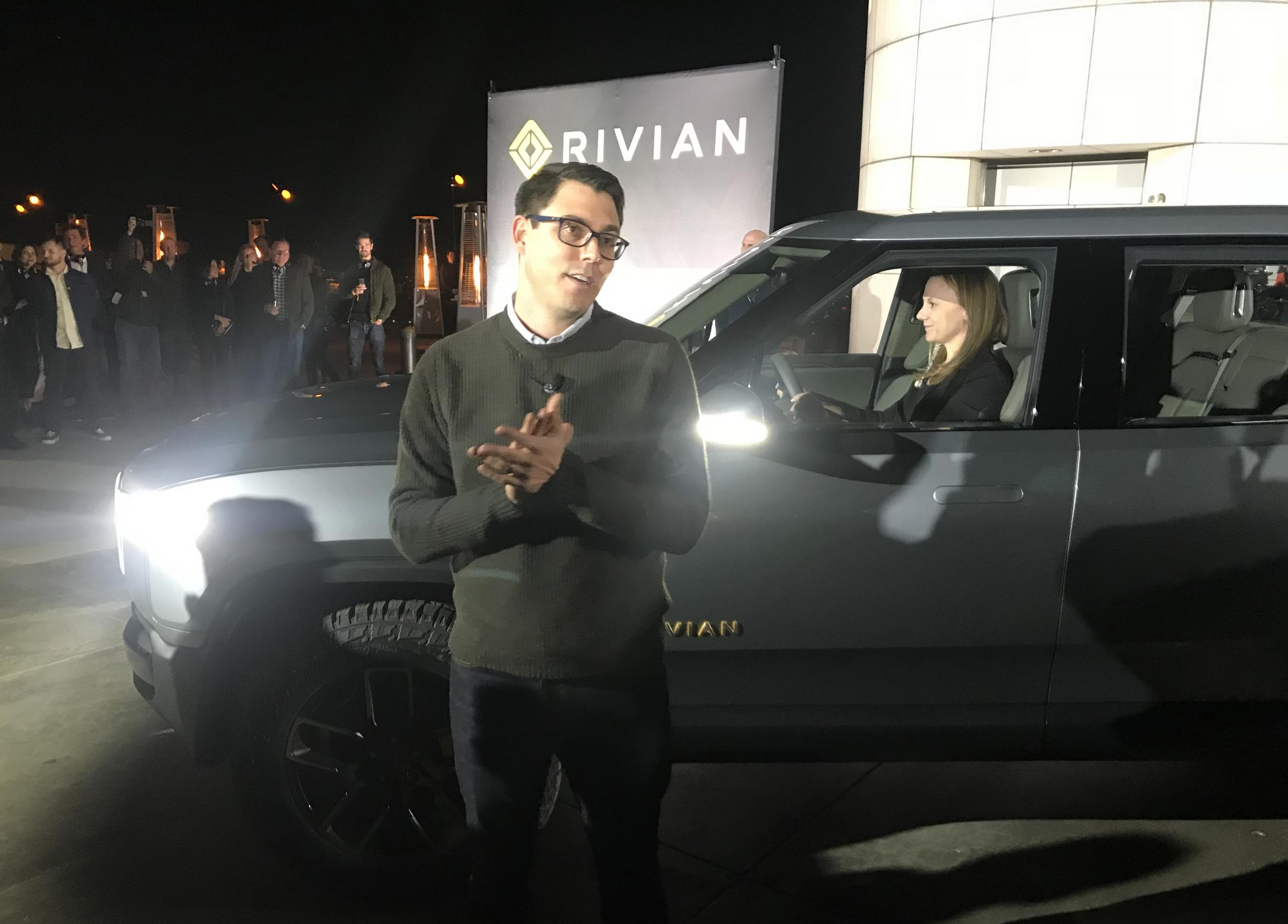 Rivian founder and CEO RJ Scaringe speaks to the crowd  at the Griffith Observatory in Los Angeles. Behind him is the R1T pickup truck.   (photo courtesy of Ryan Denham/WGLT)
