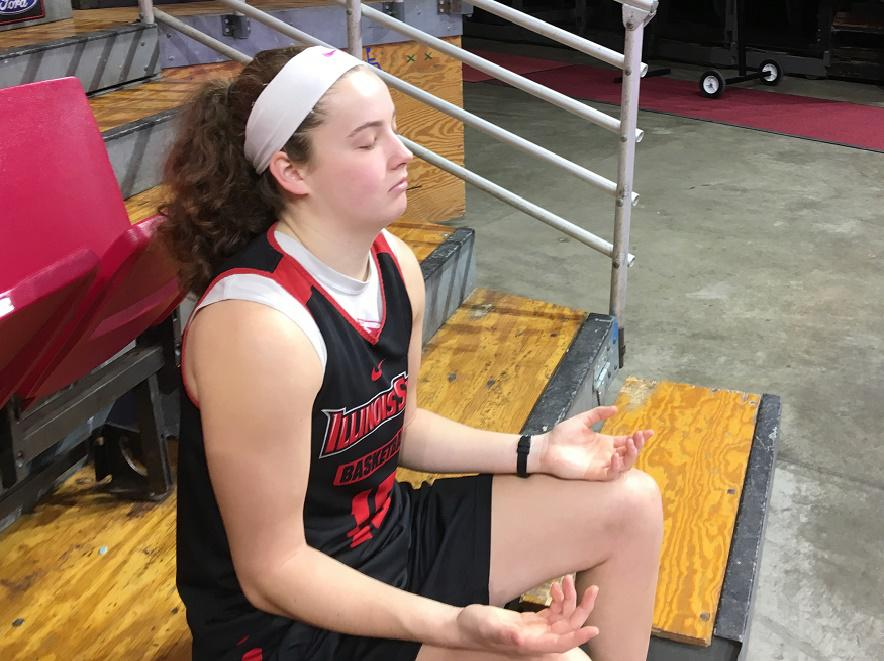 Illinois State junior basketball player Frannie Corrigan demonstrates a mindfulness exercise before a recent practice at Redbird Arena.   (photo courtesy of WGLT/Eric Stock)