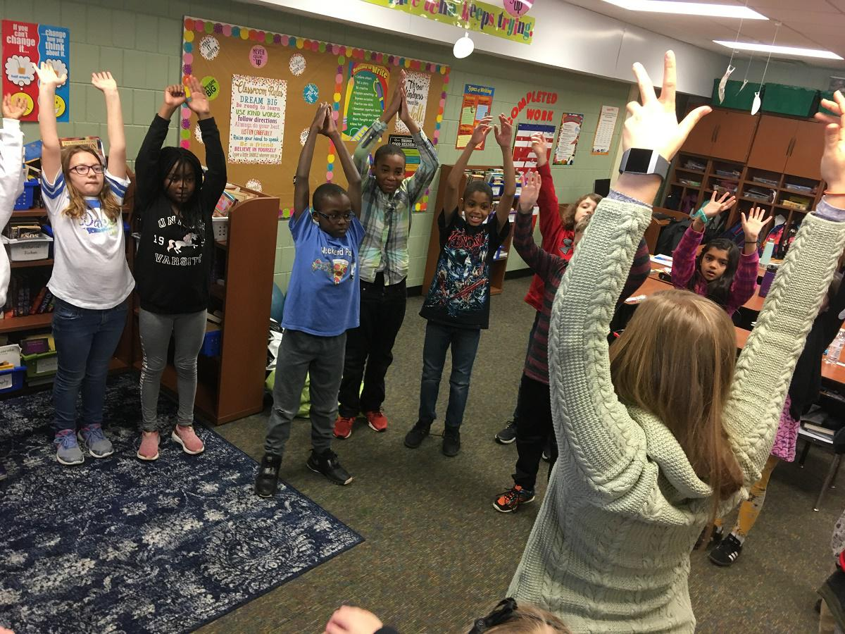 Abby Lyons leads a stretching exercise for fifth grade students at Oakdale Elementary School in Normal.   (photo courtesy of WGLT/Eric Stock)