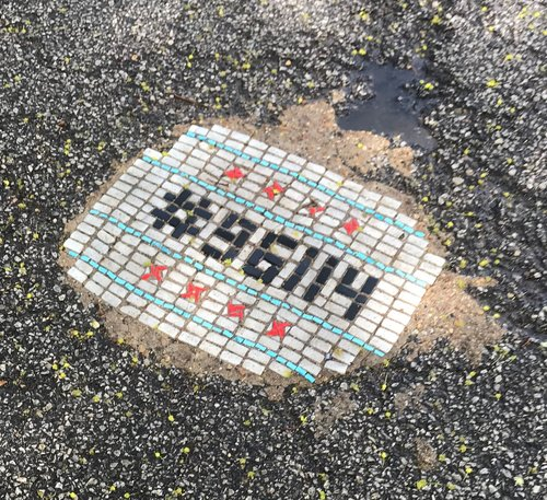 One of the more than 50 mosaics Jim Bacor has installed in potholes around Chicago