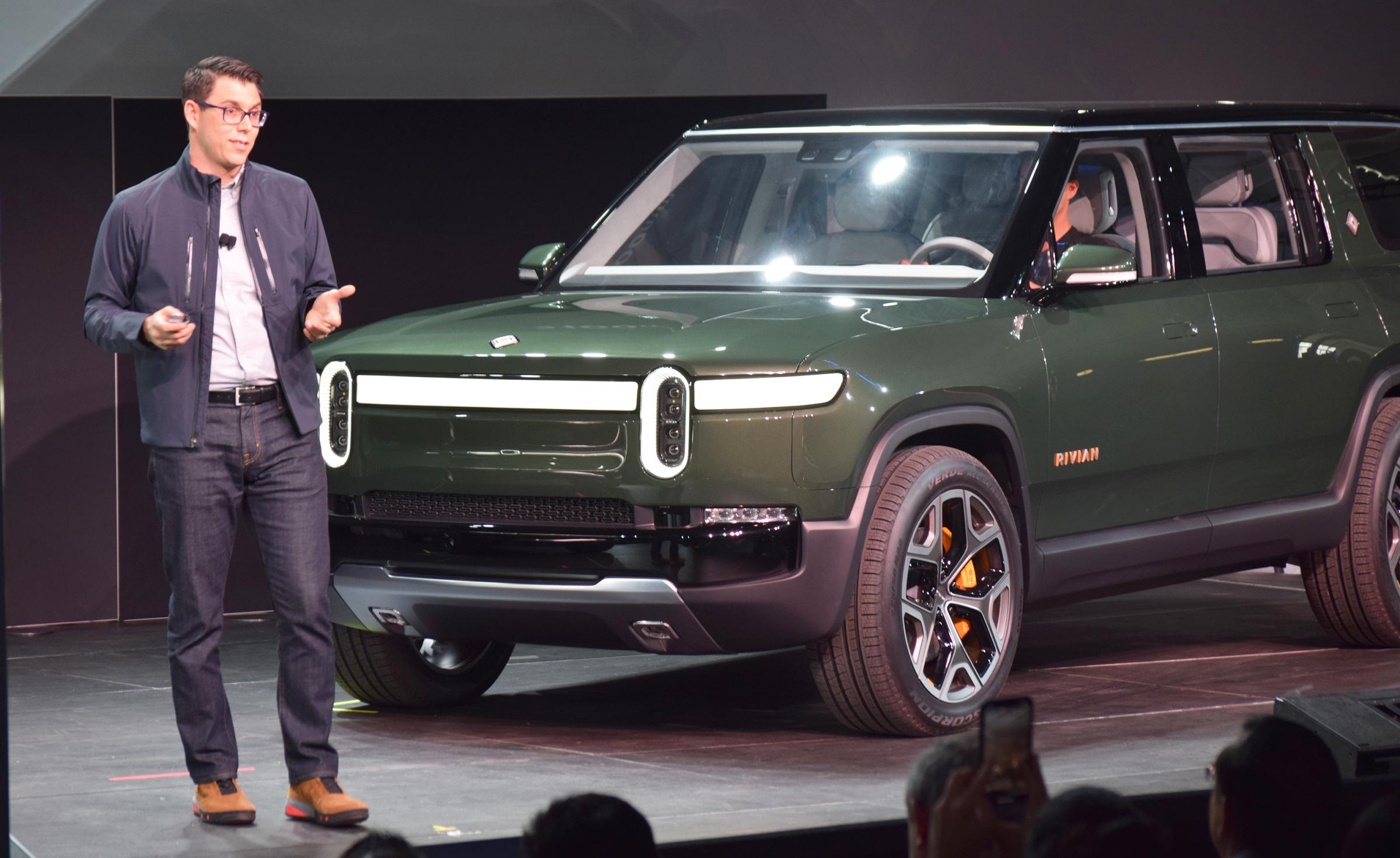 Rivian founder and CEO RJ Scaringe with the new R1S SUV at the LA Auto Show.  (photo courtesy of WGLT)