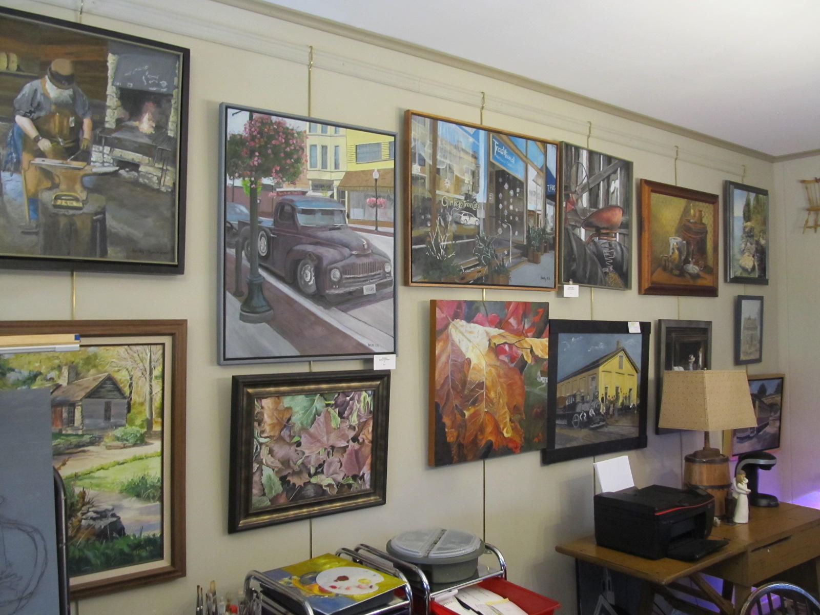 A wall of Beck Hundrieser's studio is filled with her paintings. All the artists' studios are filled with examples of their work.  (photo courtesy of Guy Stephens/WNIJ)
