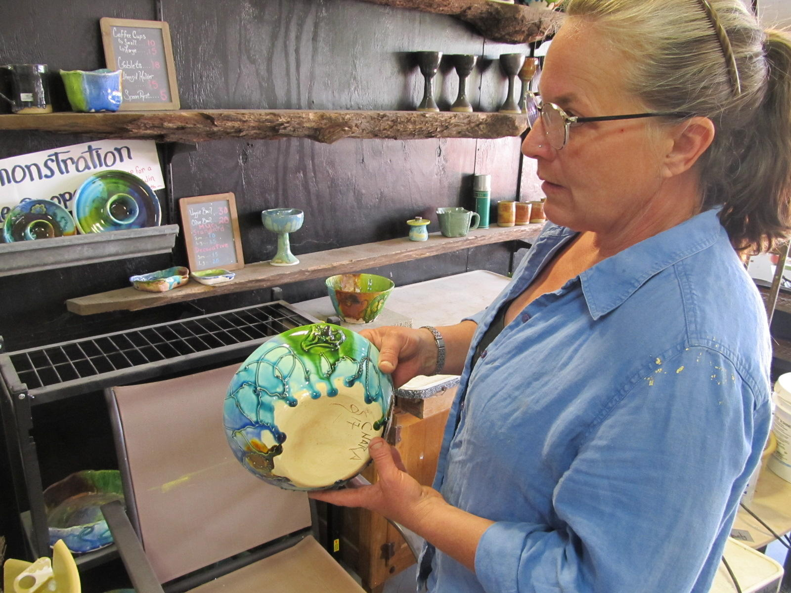 Sally Jane Cooper of Chara Pottery Studio with a piece in one of several styles she works in. She and Tonya Hardy will demonstrate ceramic techniques and show their work at the studio for the tour.  (photo courtesy of Guy/Stephens/WNIJ)