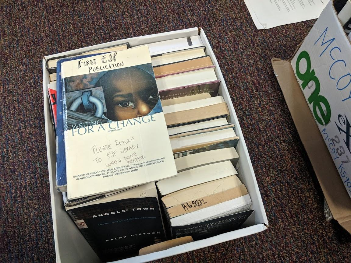 One of several boxes of books removed from the Education Justice Project's library inside the Danville Correctional Center. Staff at the prison removed the books from the library earlier this year (ohoto courtesy of Lee Gaines)