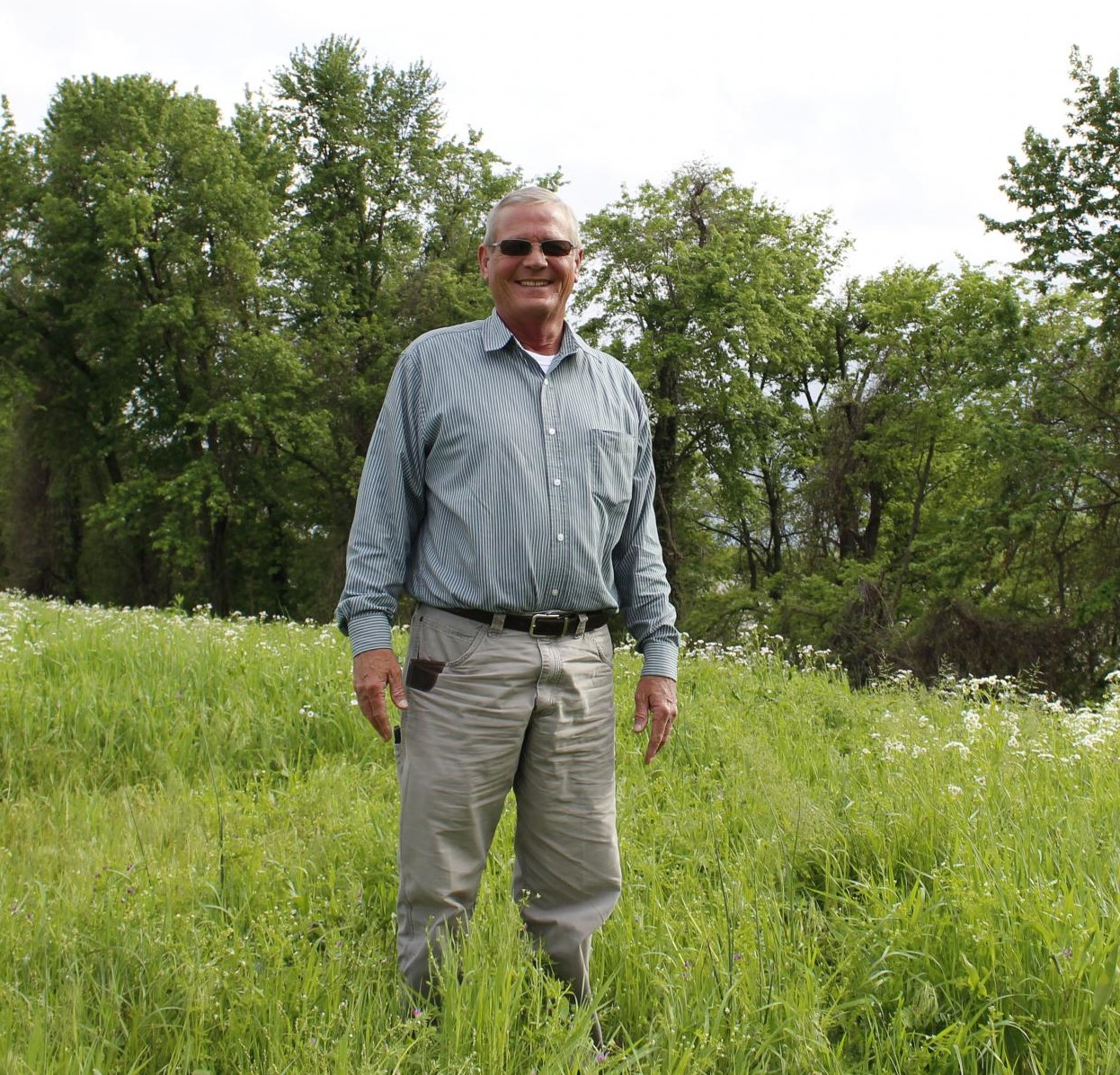 Larry Klein, who is one the local port authority board and works with the utility, stands next to the Mississippi River on land where they're hoping to build a port. The city owns this land, but the utility manages it. (photo courtesy of  Madelyn Beck Illinois Newsroom)