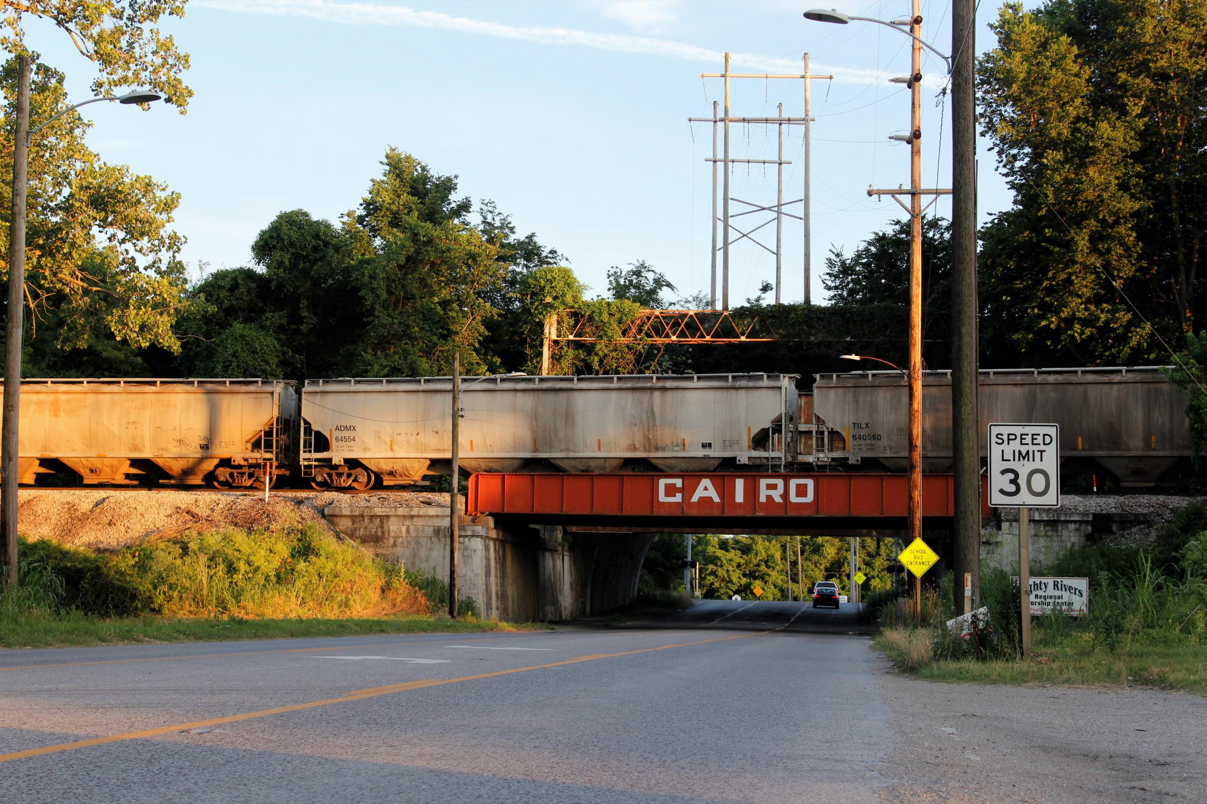 Driving into Cairo from the north, you pass a funeral home and a bridge underneath a rail line. There are structures behind this bridge that shut it off in case of massive flooding from the nearby Ohio and Mississippi rivers. (Photo courtesy  Madelyn Beck / Illinois Newsroom)