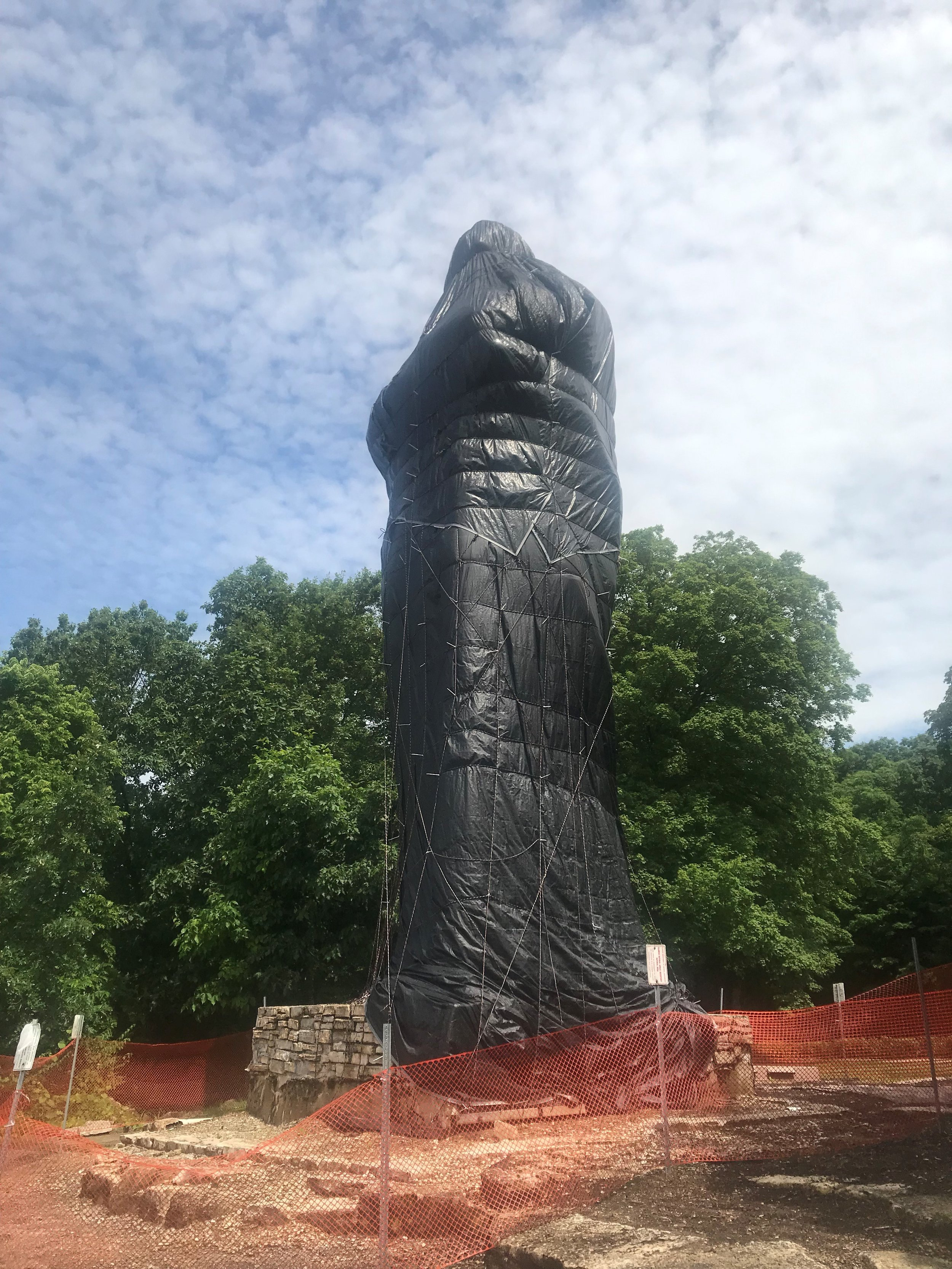 The Eternal Indian statue is wrapped in plastic awaiting a complete restoration project